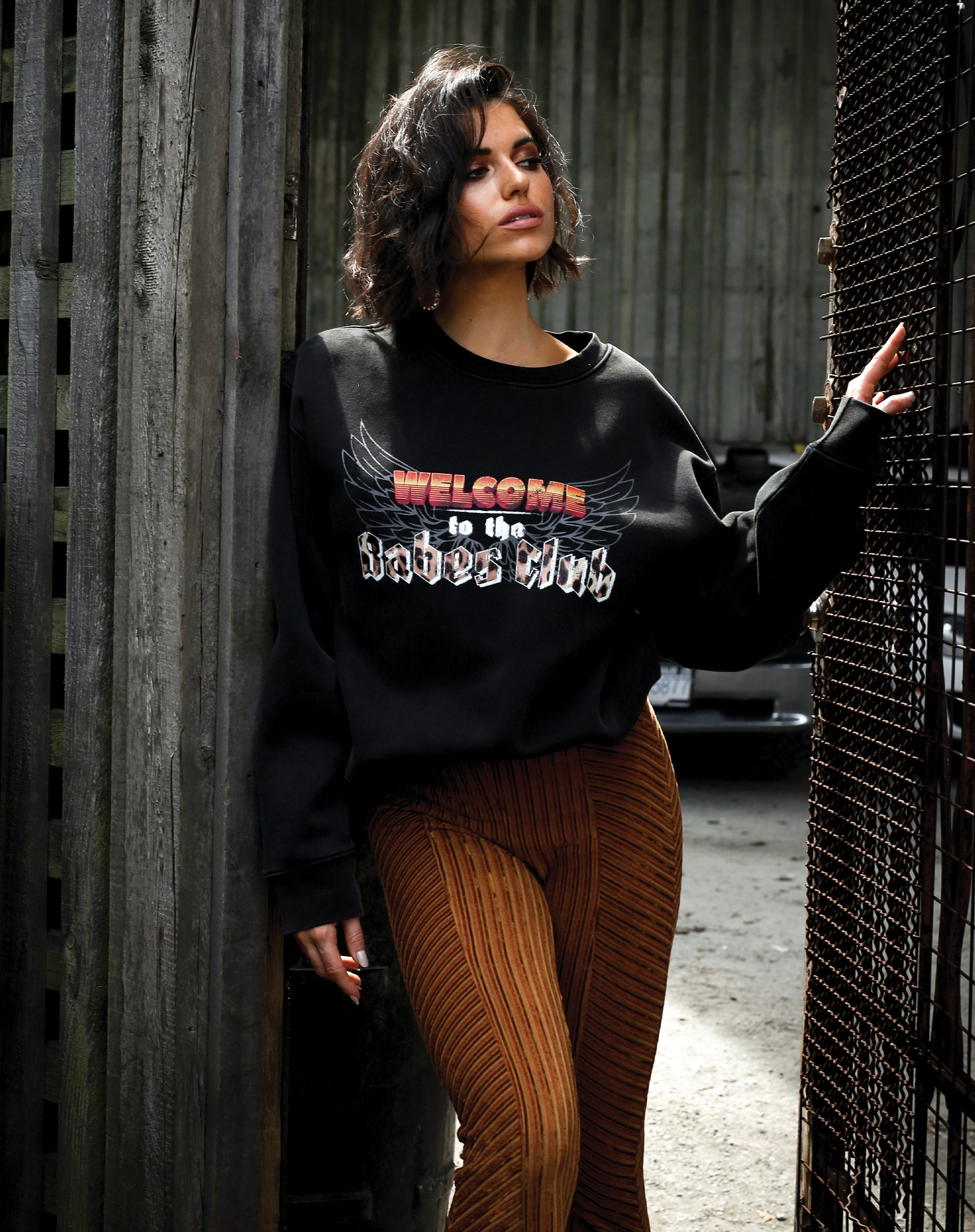 Photo of the Welcome to the Babes Club step sister crew neck sweatshirt from The 1981 Collection by Brunette the Label.