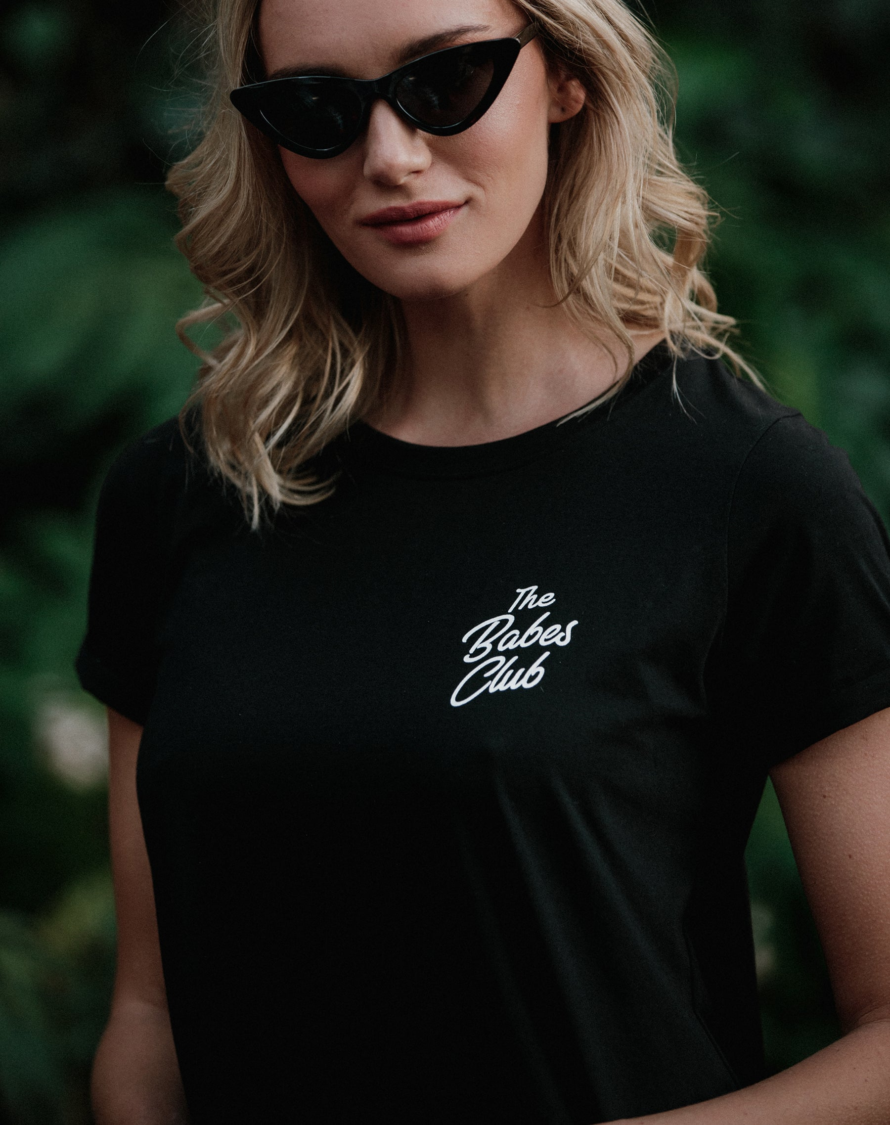 Close up photo of the Babes Club tee dress in black by Brunette the Label.