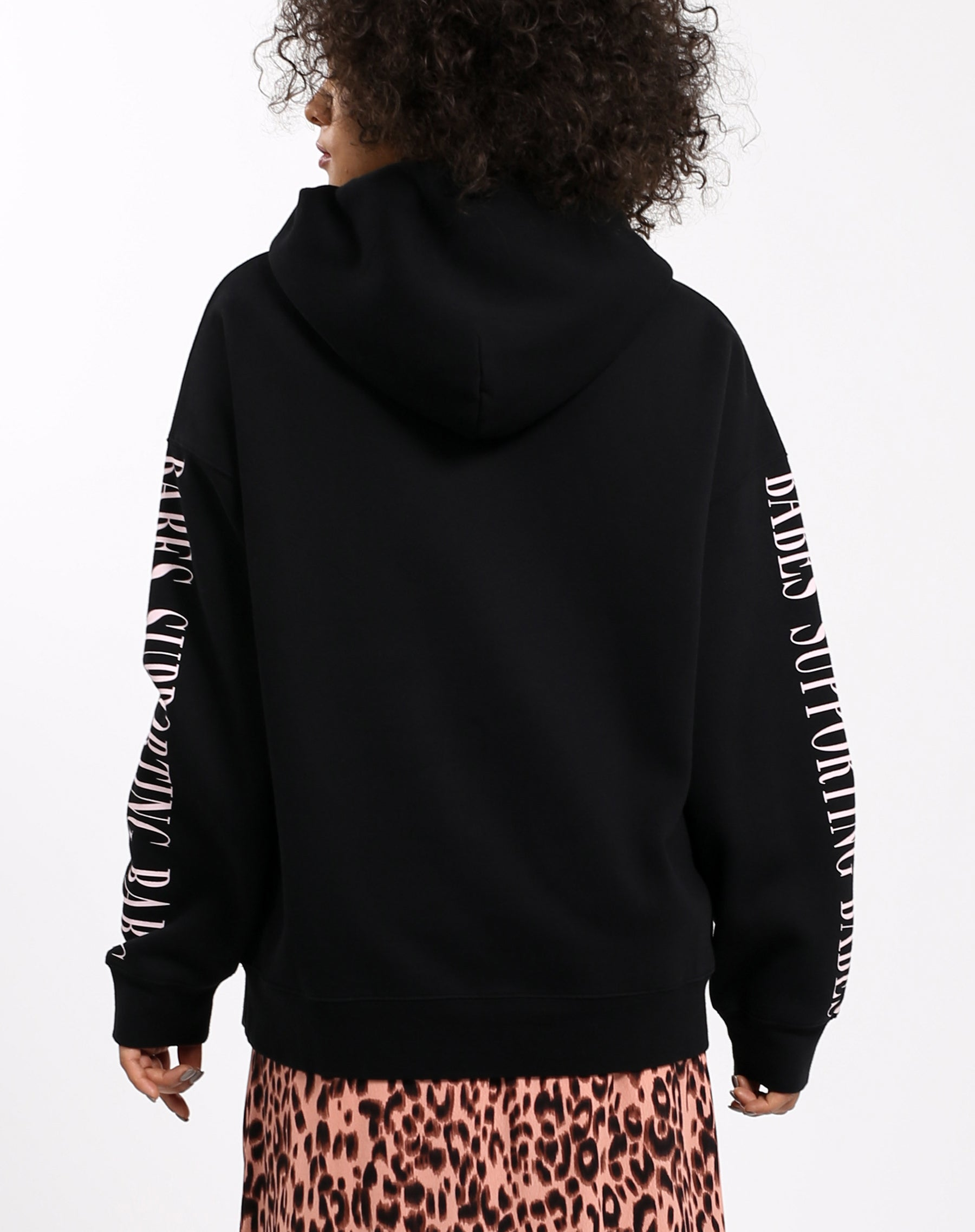 Photo of the back of the Babes Supporting Babes big sister hoodie in pink and black by Brunette the Label.