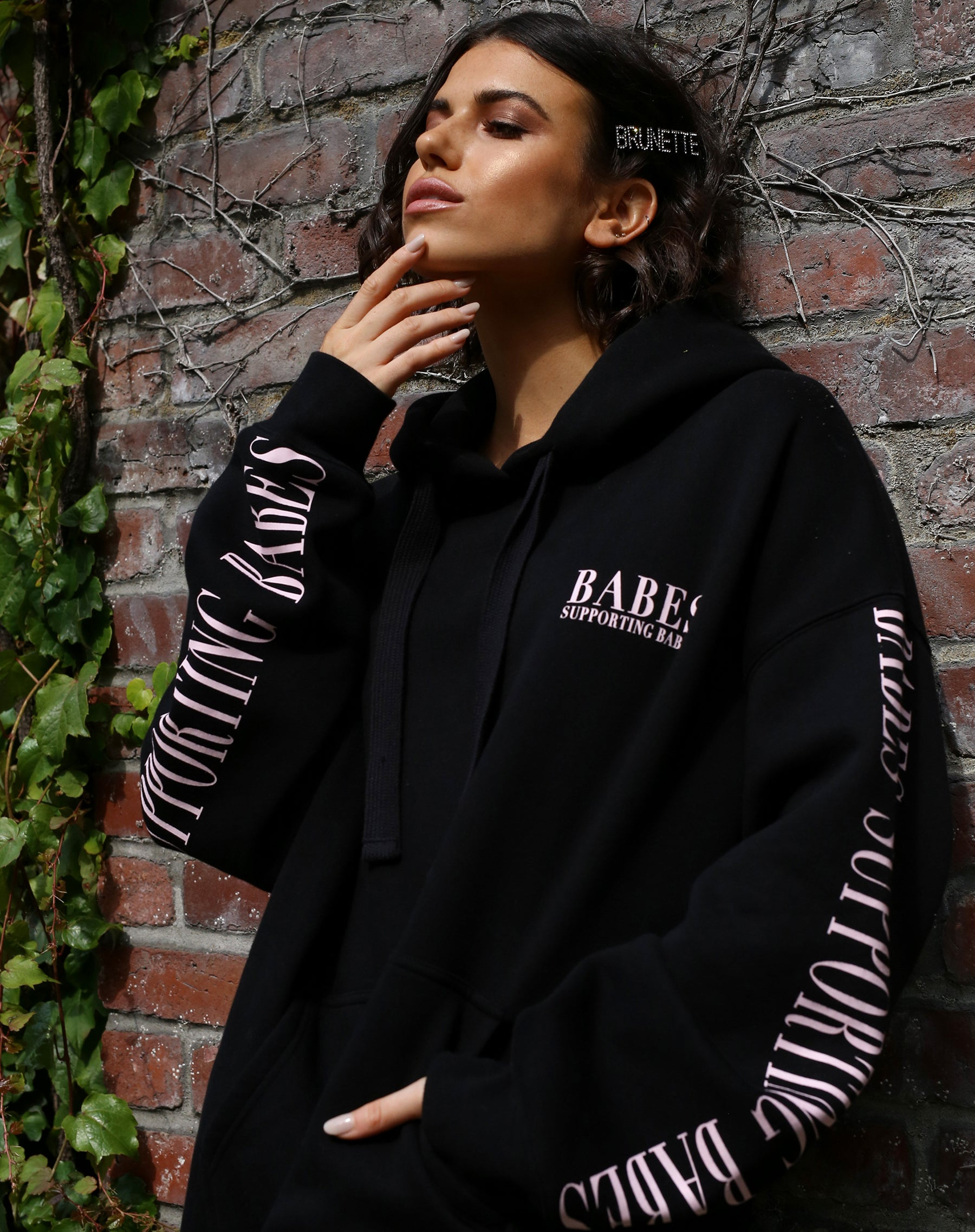 The Babes Supporting Babes big sister hoodie in pink and black by Brunette the Label.