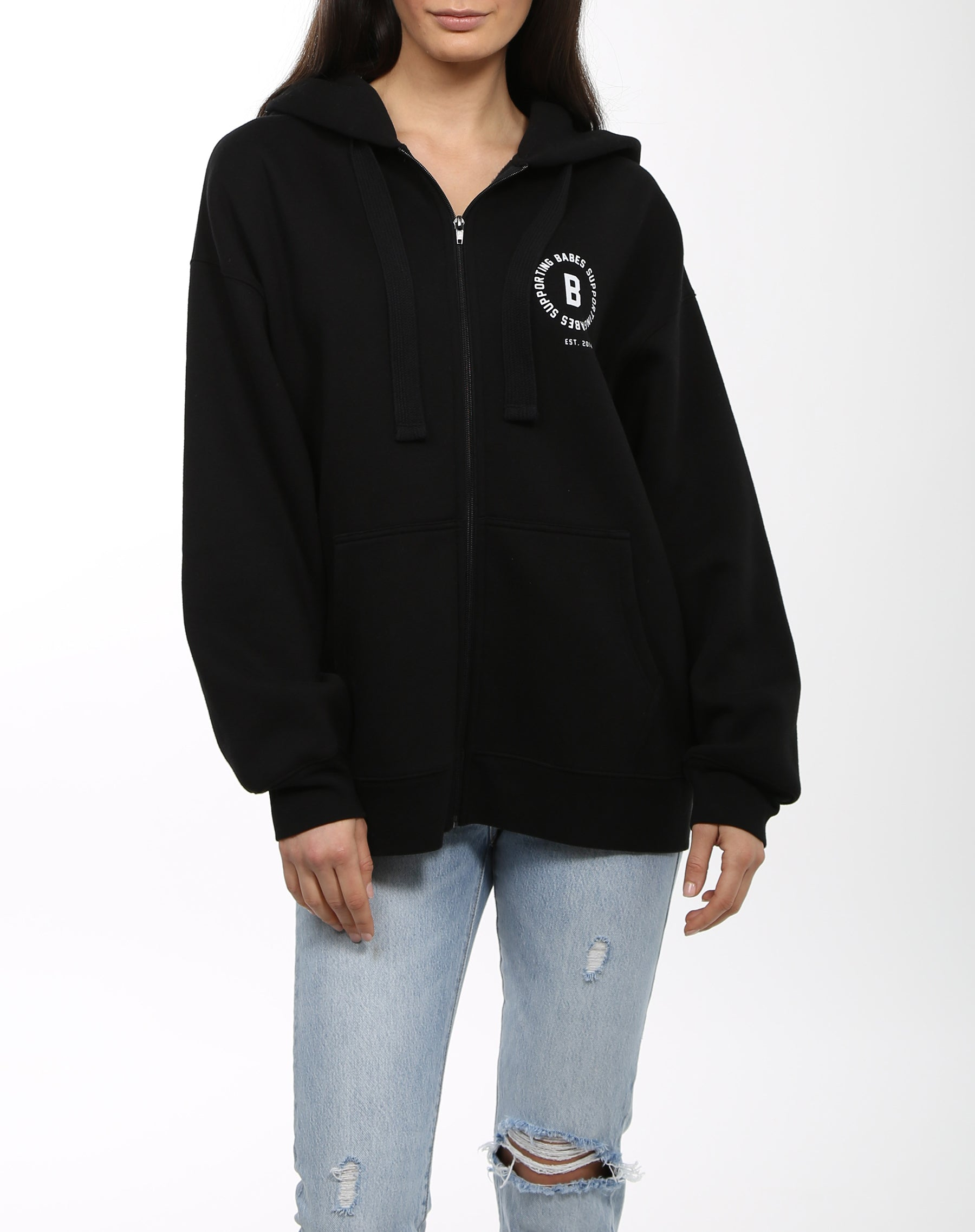 Photo 5 of the Babes Supporting Babes big sister zip up hoodie in black by Brunette the Label.