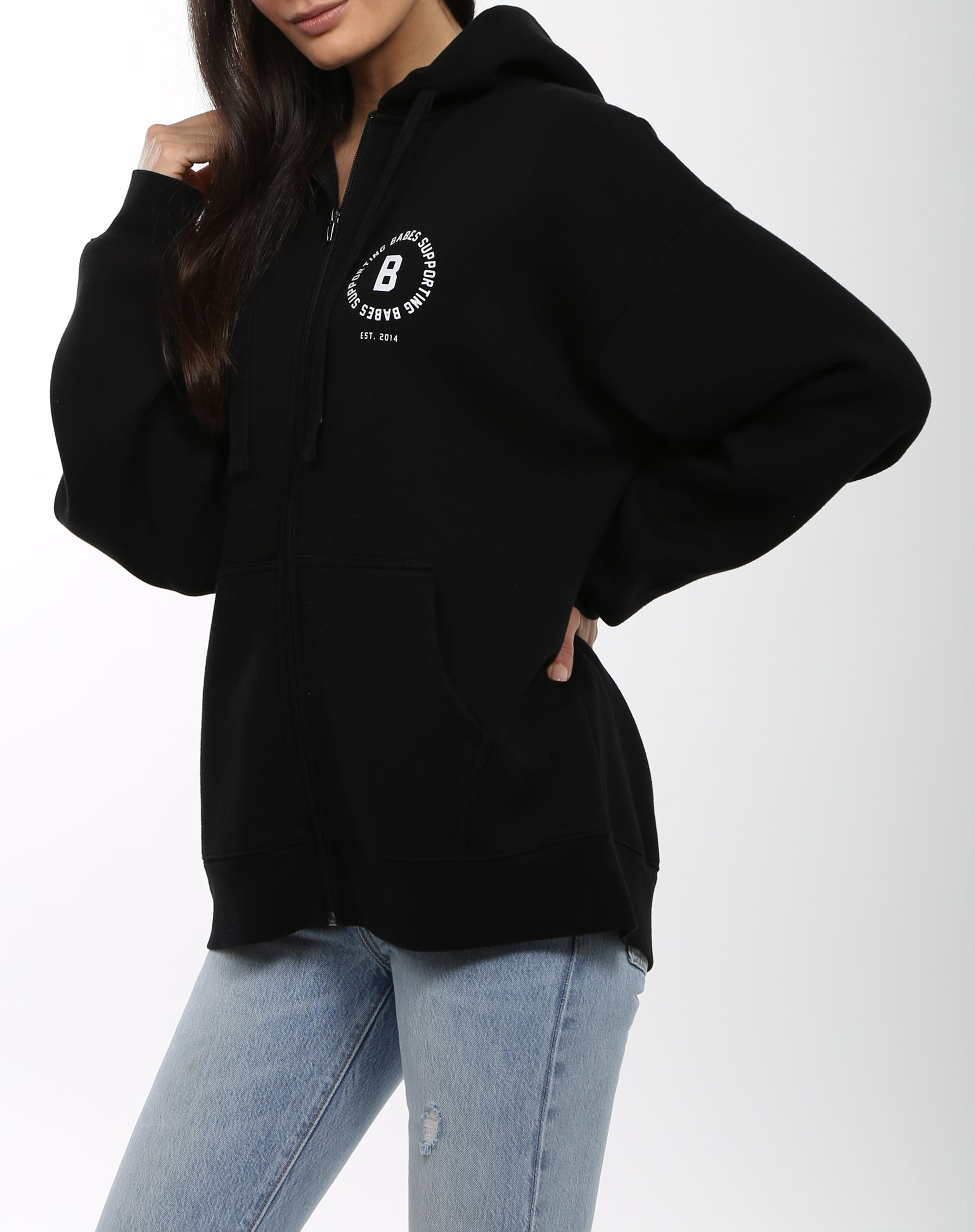 Side photo of the Babes Supporting Babes big sister zip up hoodie in black by Brunette the Label.