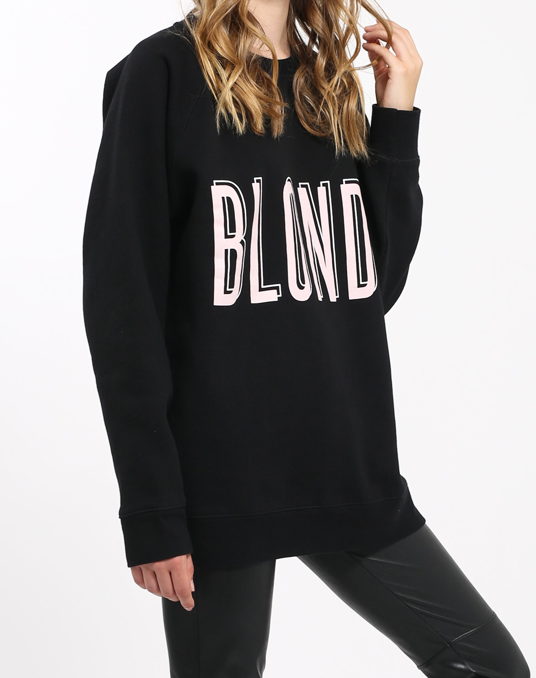Photo of the side of the Blonde big sister crew neck sweatshirt in pink by Brunette the Label.