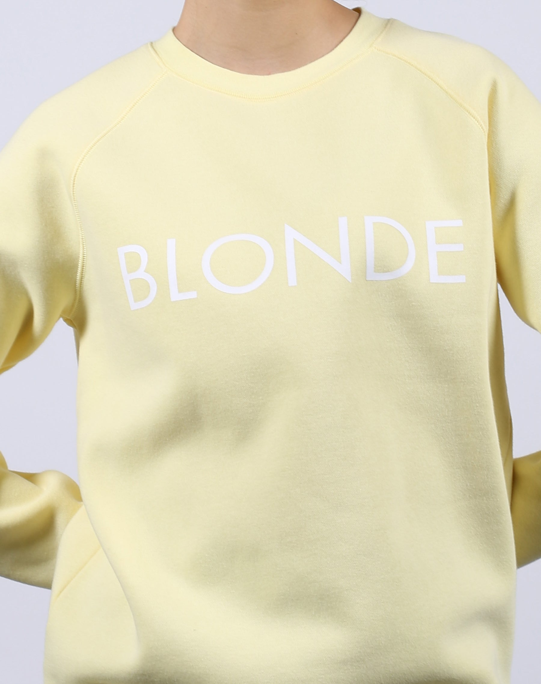 This is a Ecommerce photo of the Blonde Lemon Classic Crew neck Sweatshirt by Brunette the Label
