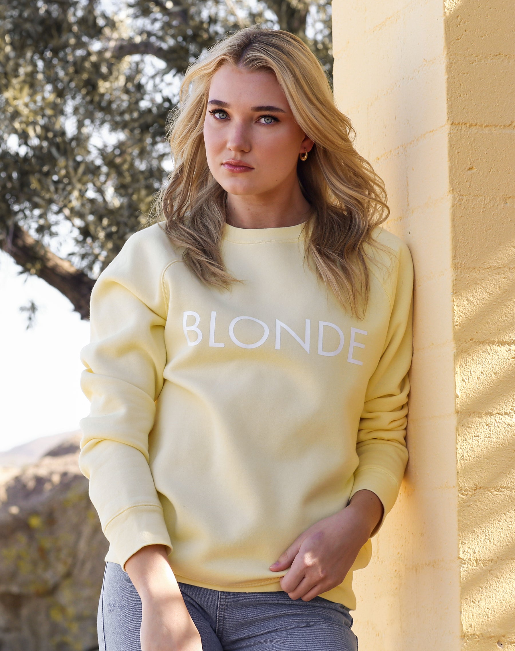 This is a campaign photo of the Blonde Lemon Classic Crew neck Sweatshirt by Brunette the Label