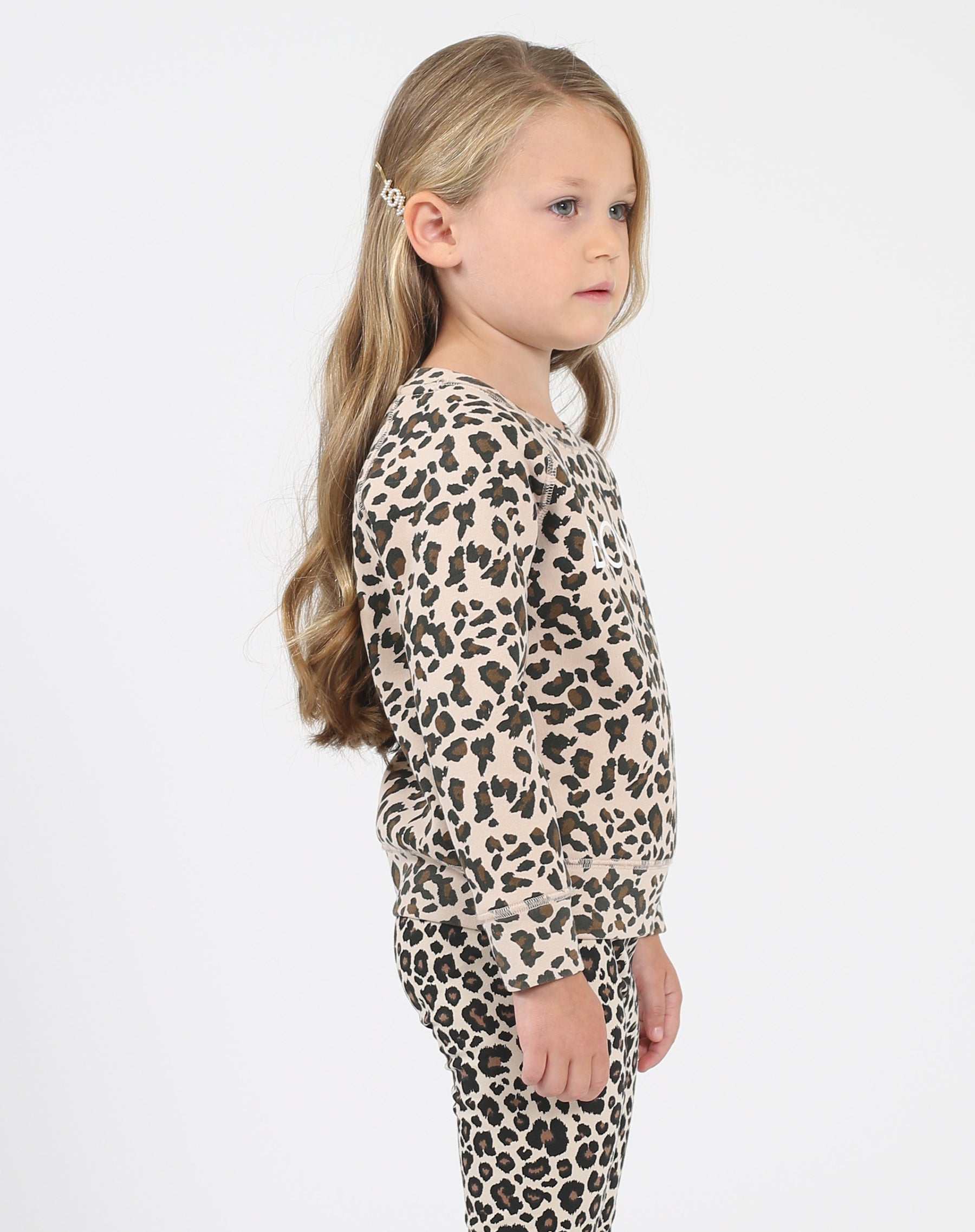 Photo of the side of the Blonde Little Babes classic crew neck sweatshirt in leopard by Brunette the Label.