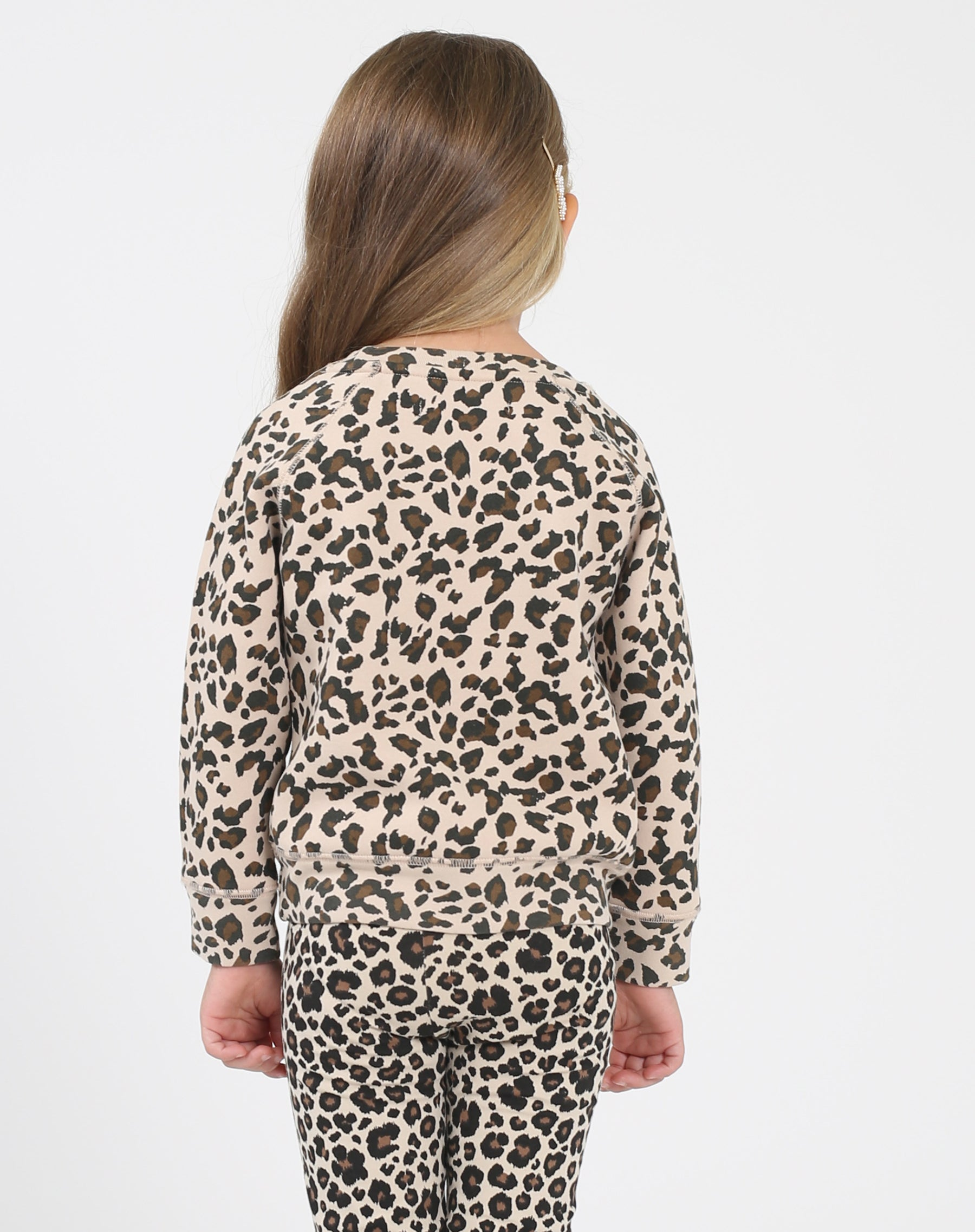 Photo of the back of the Blonde Little Babes classic crew neck sweatshirt in leopard by Brunette the Label.