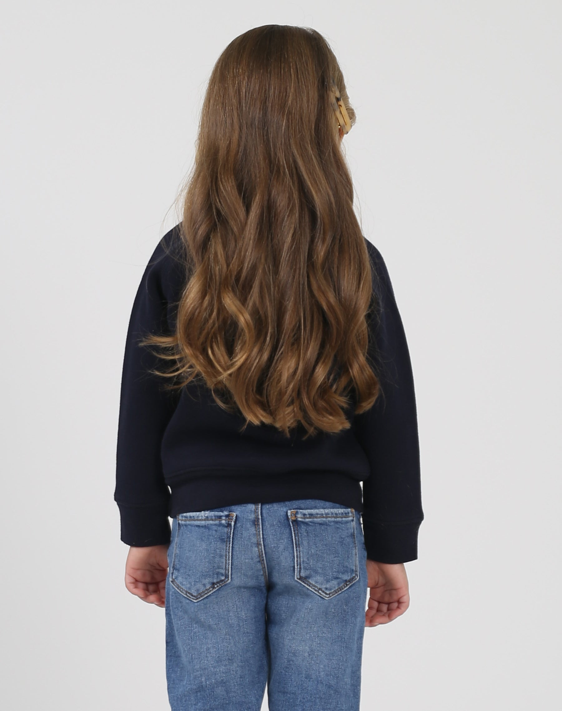 Photo of the back of the Blonde Little Babes classic crew neck sweatshirt in navy by Brunette the Label.