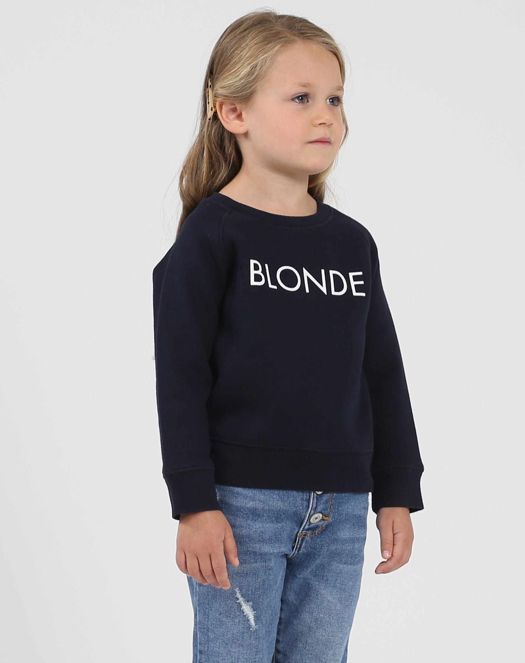 Photo of the side of the Blonde Little Babes classic crew neck sweatshirt in navy by Brunette the Label.