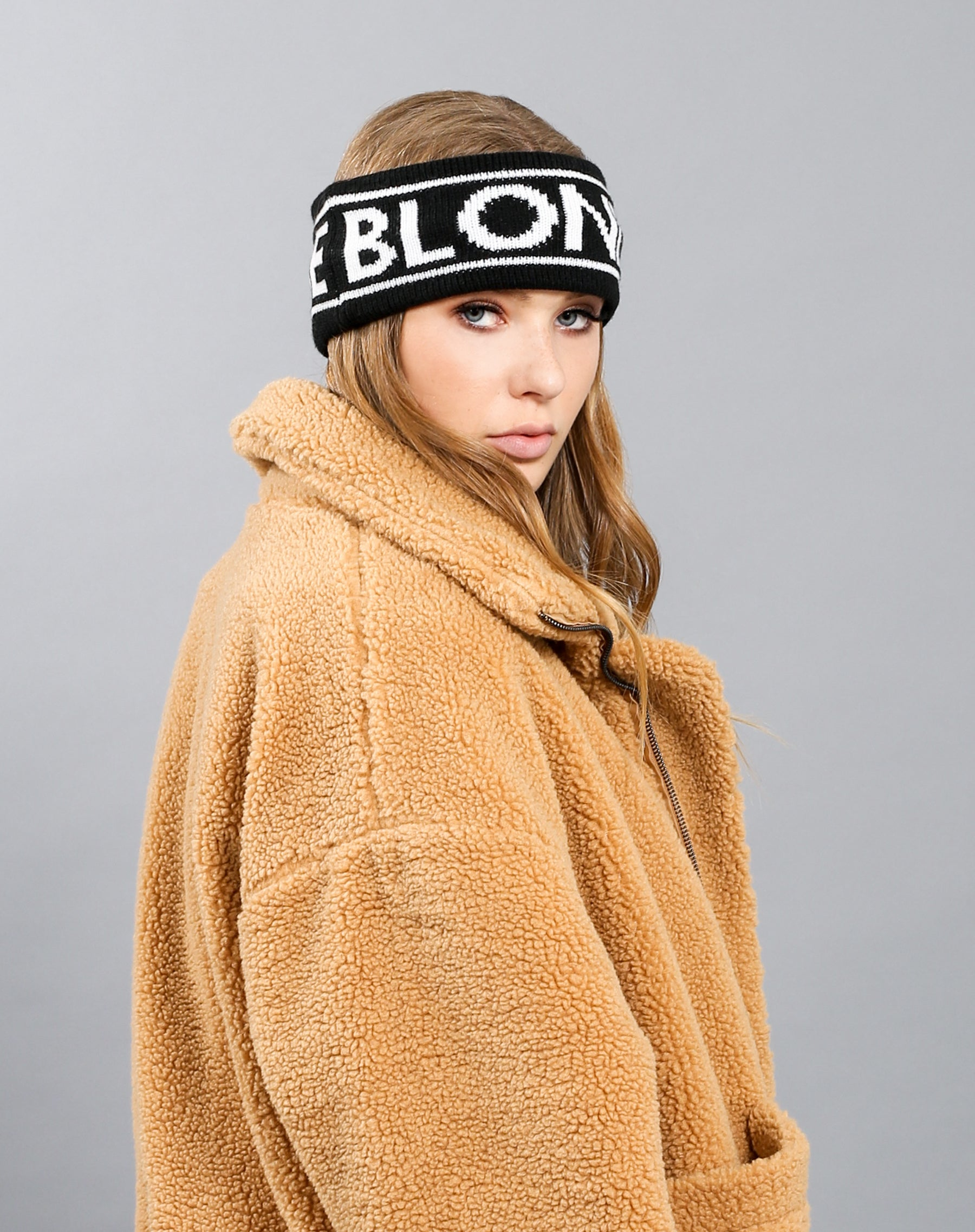 Side photo of the Blonde Headband in black by Brunette the Label.