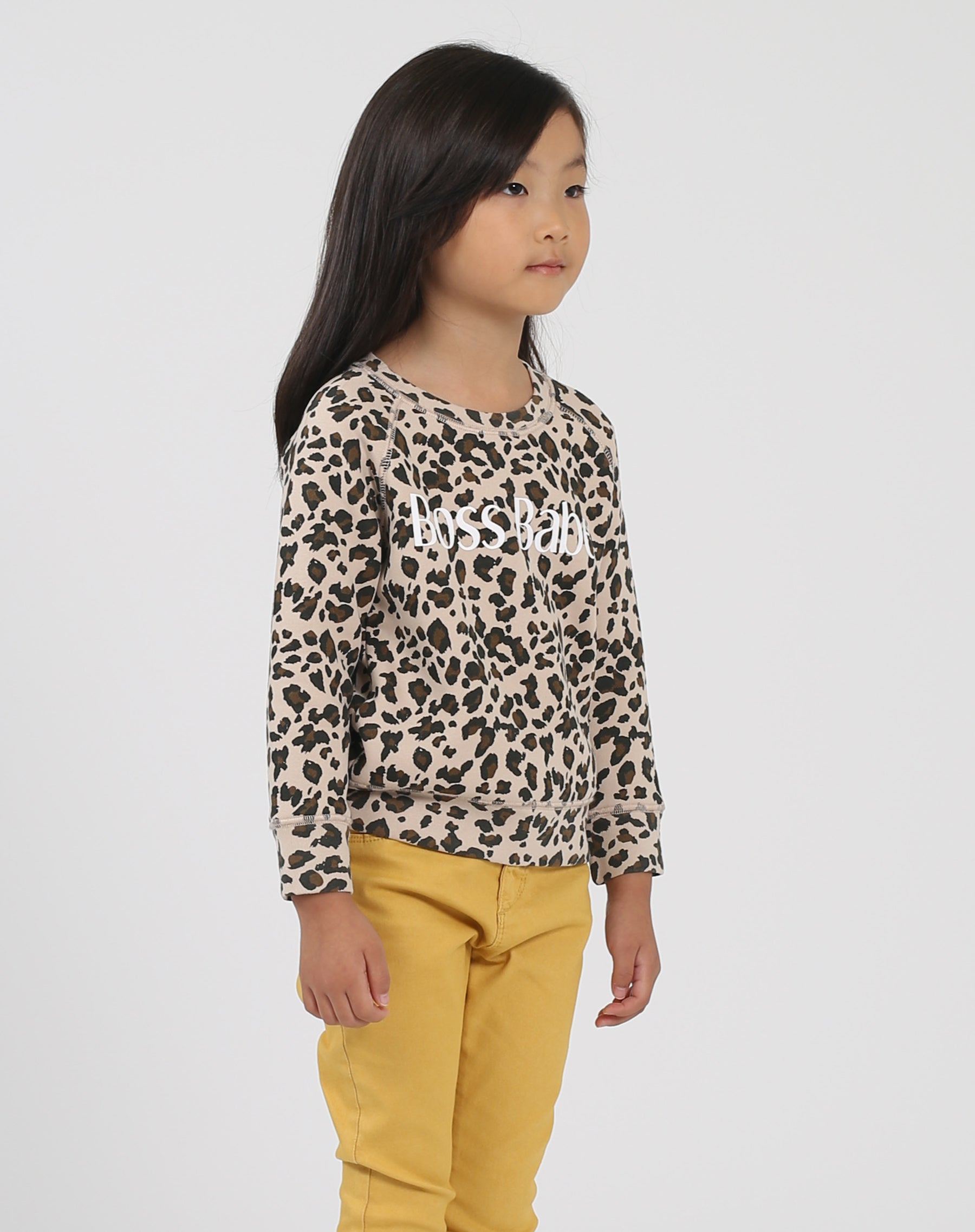 Photo of the side of the Boss Babe Little Babes classic crew neck sweatshirt in leopard by Brunette the Label.