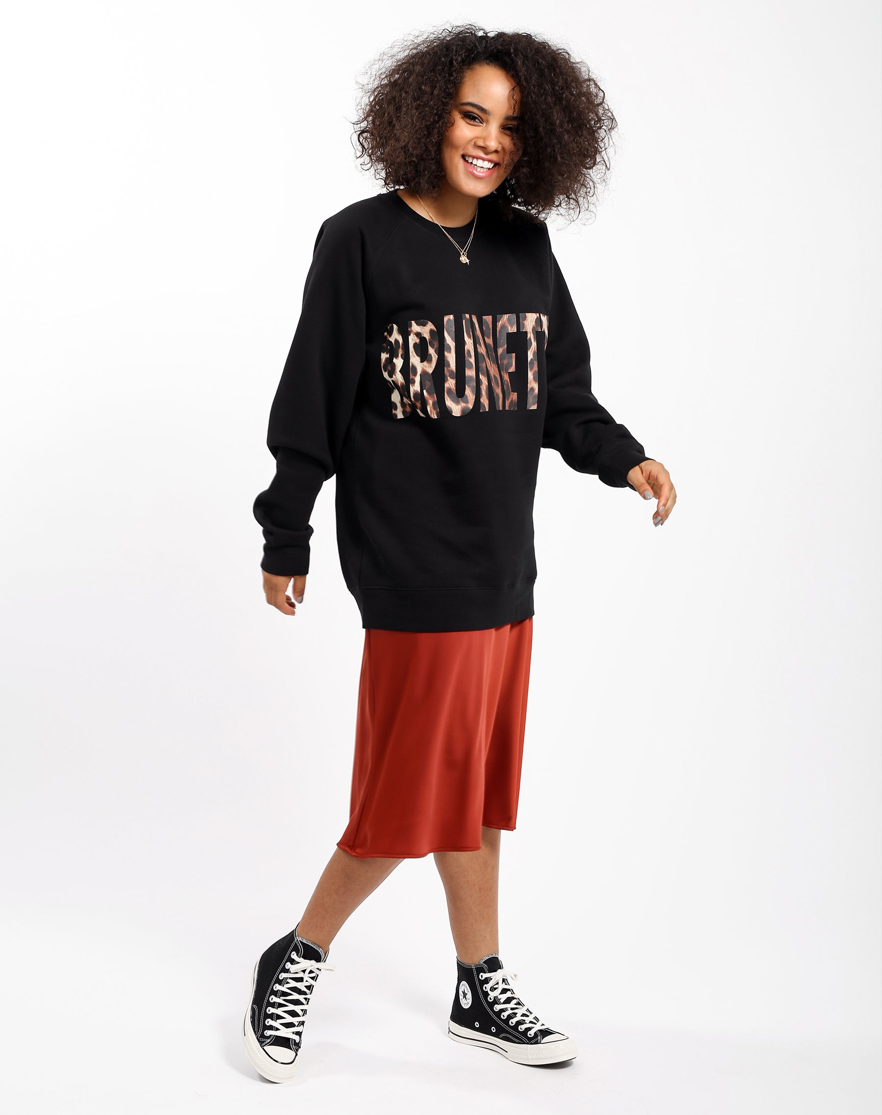 Side photo of the Brunette big sister crew neck sweatshirt in Leopard by Brunette the Label.