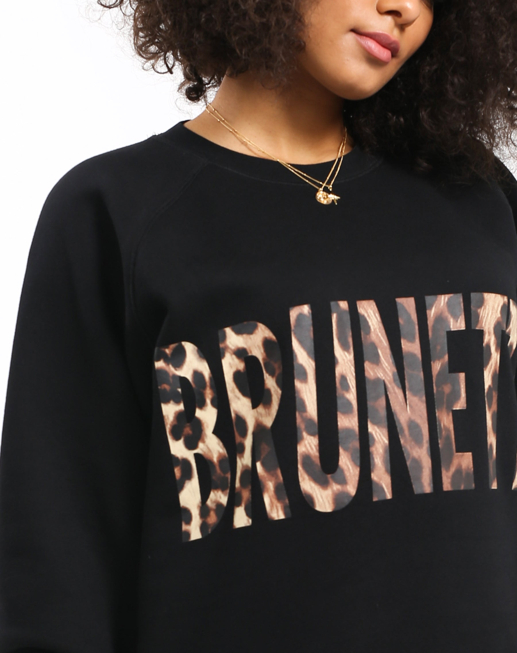 Close up photo of the Brunette big sister crew neck sweatshirt in Leopard by Brunette the Label.