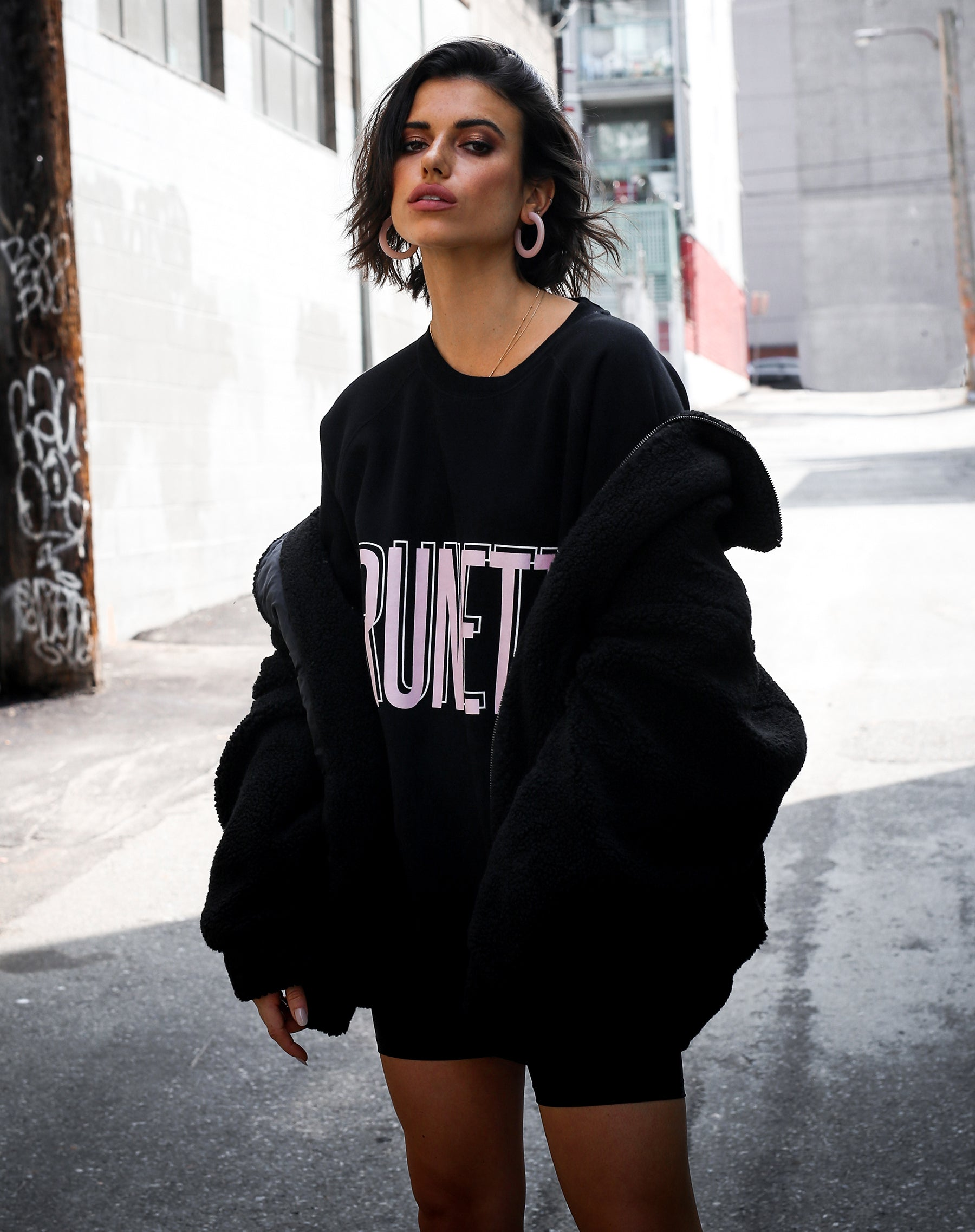 Photo of the Brunette big sister crew neck sweatshirt in pink by Brunette the Label.
