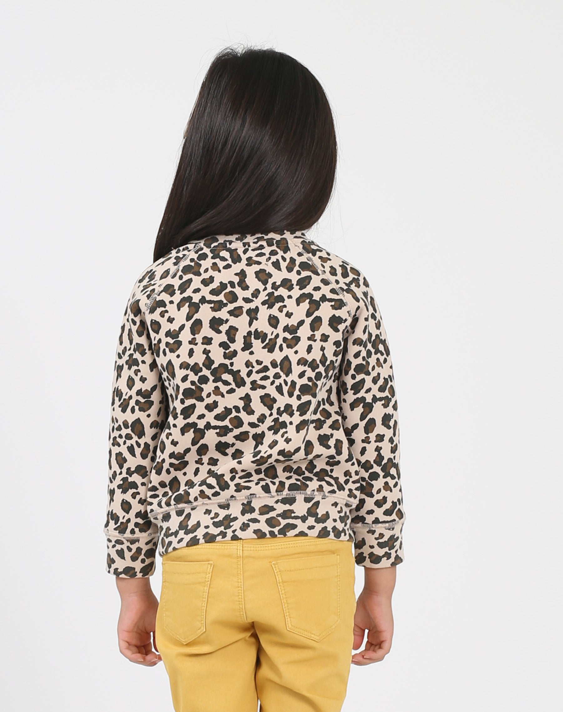 Photo of the back of the Jet Black Little Babes classic crew neck sweatshirt in leopard by Brunette the Label.