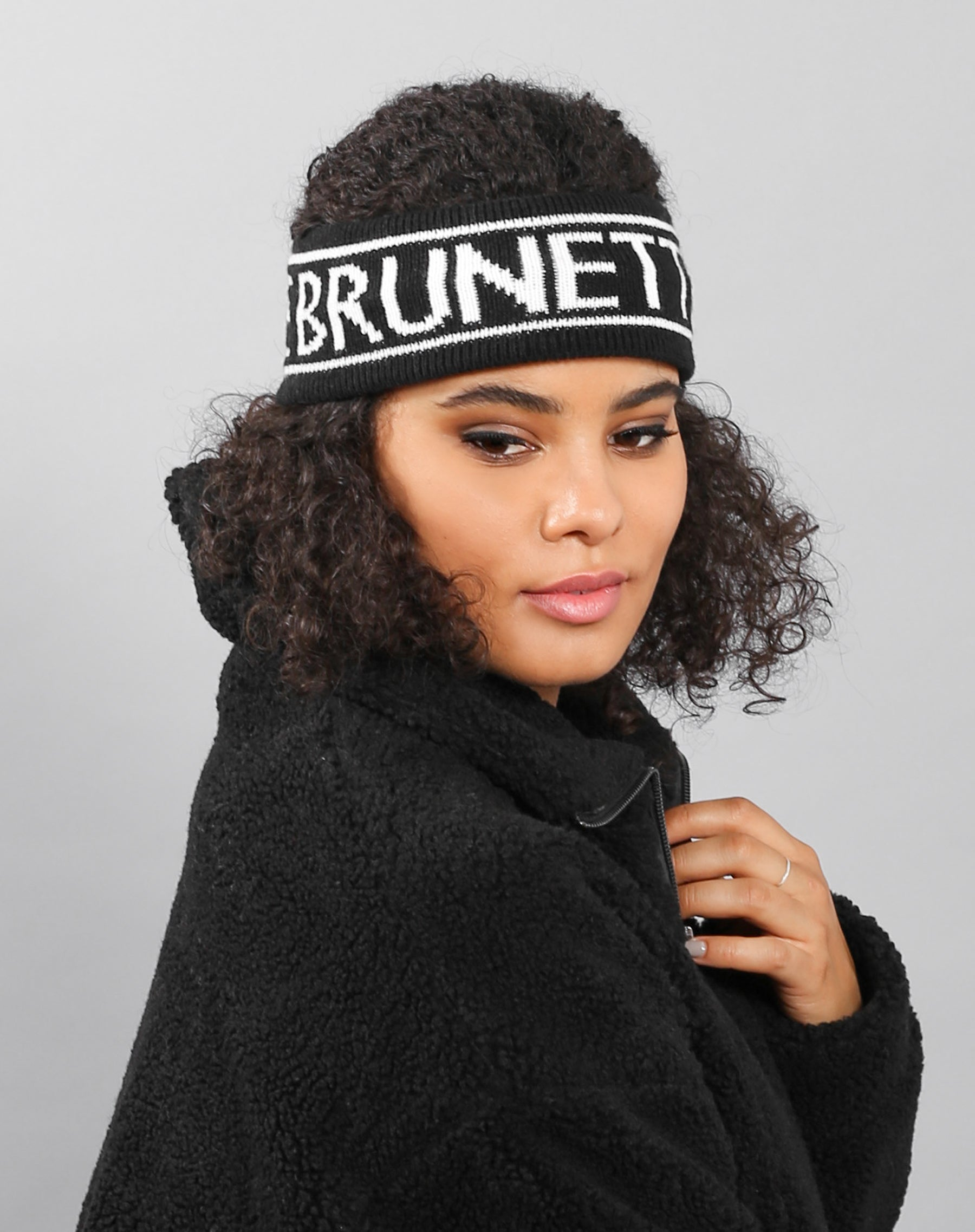 Side photo of the Brunette headband in black by Brunette the Label.