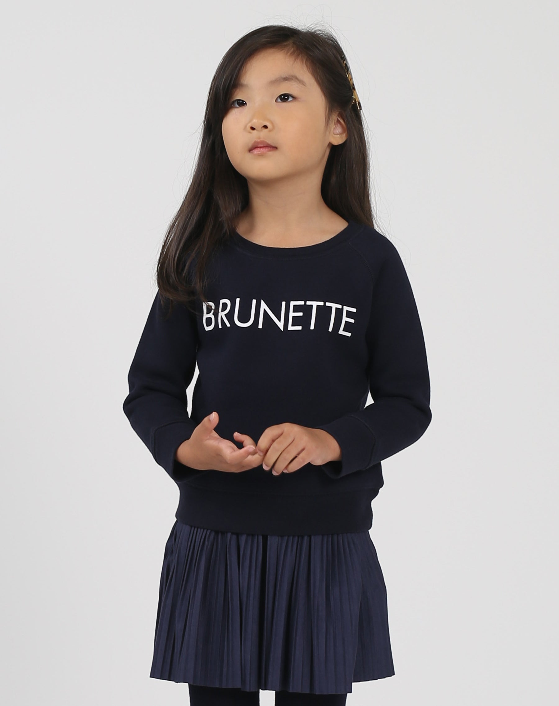 Photo of the Brunette Little Babes classic crew neck sweatshirt in navy by Brunette the Label.