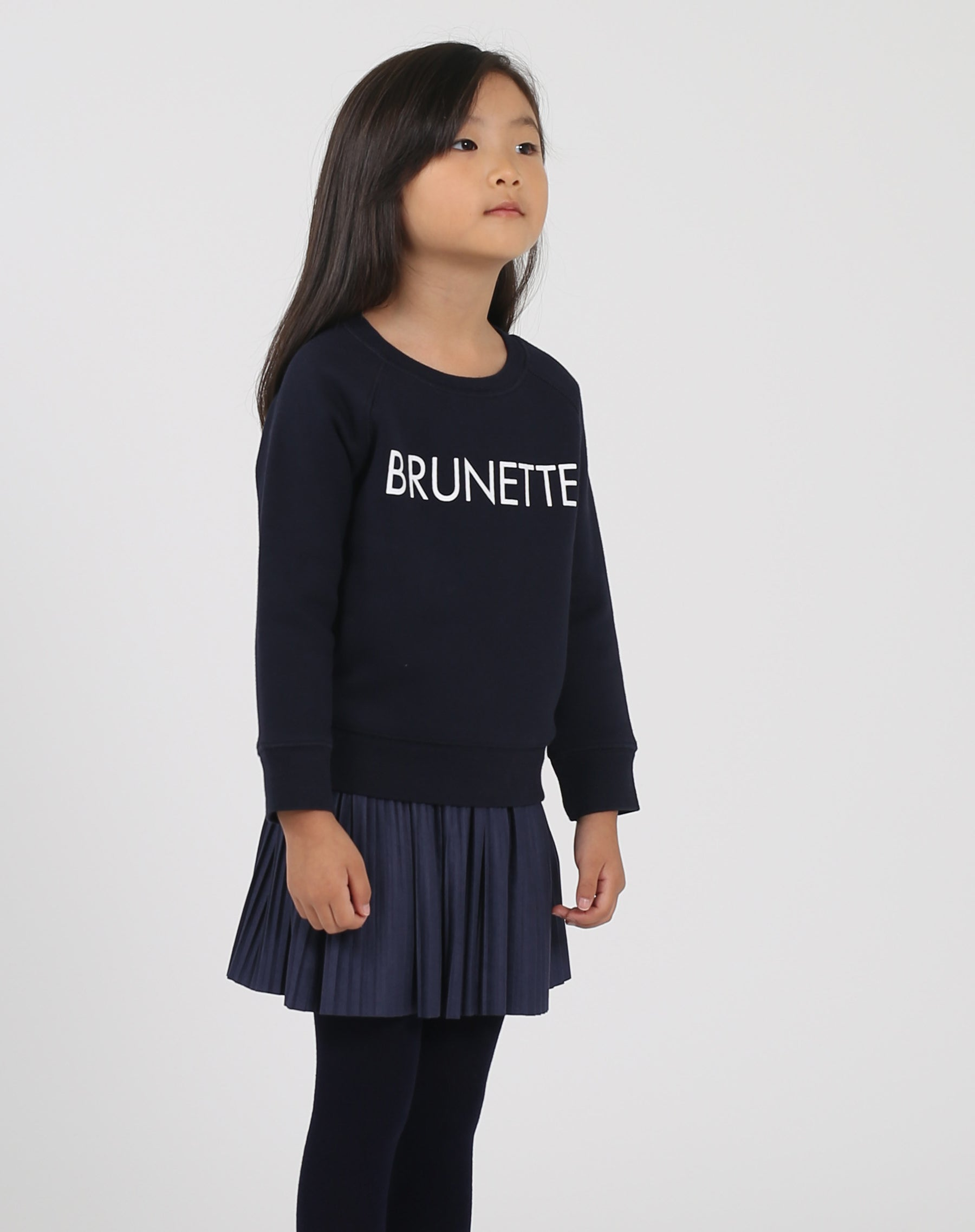 Photo of the side of the Brunette Little Babes classic crew neck sweatshirt in navy by Brunette the Label.