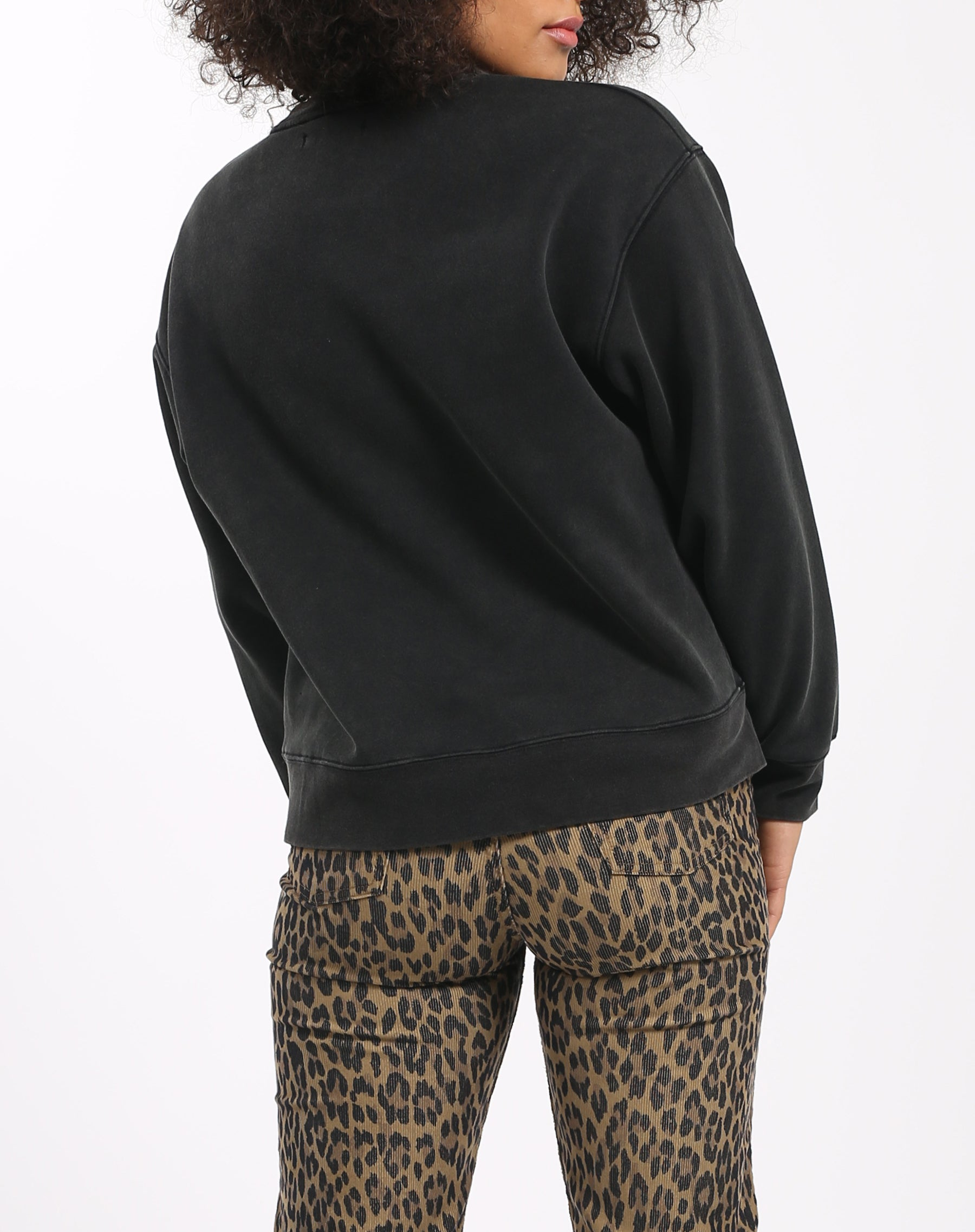 Photo of the back of the Jet Black Step Sister crew neck sweatshirt in acid wash by Brunette the Label.