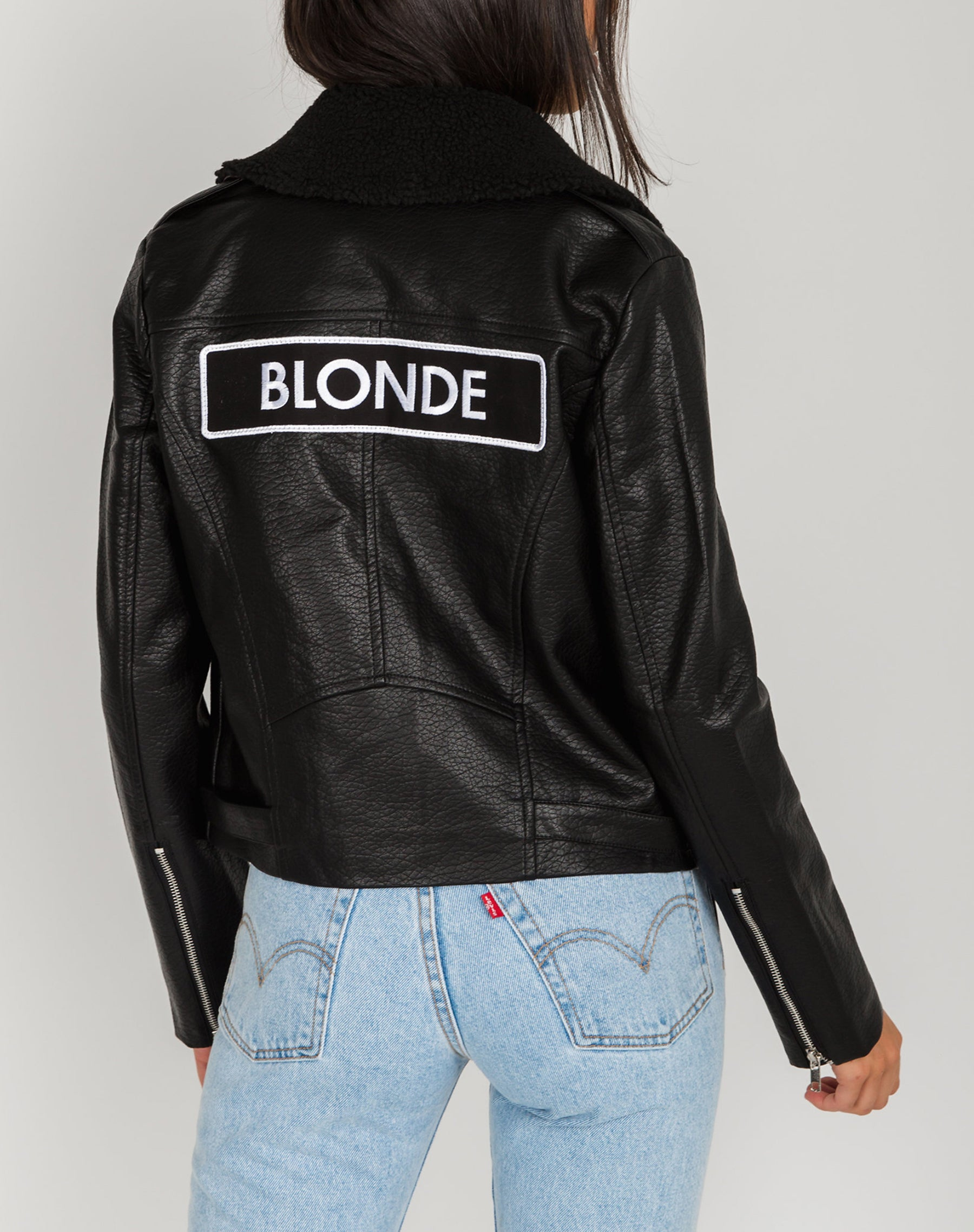 Photo of the Blonde Florence vegan leather moto jacket in black by Brunette the Label.