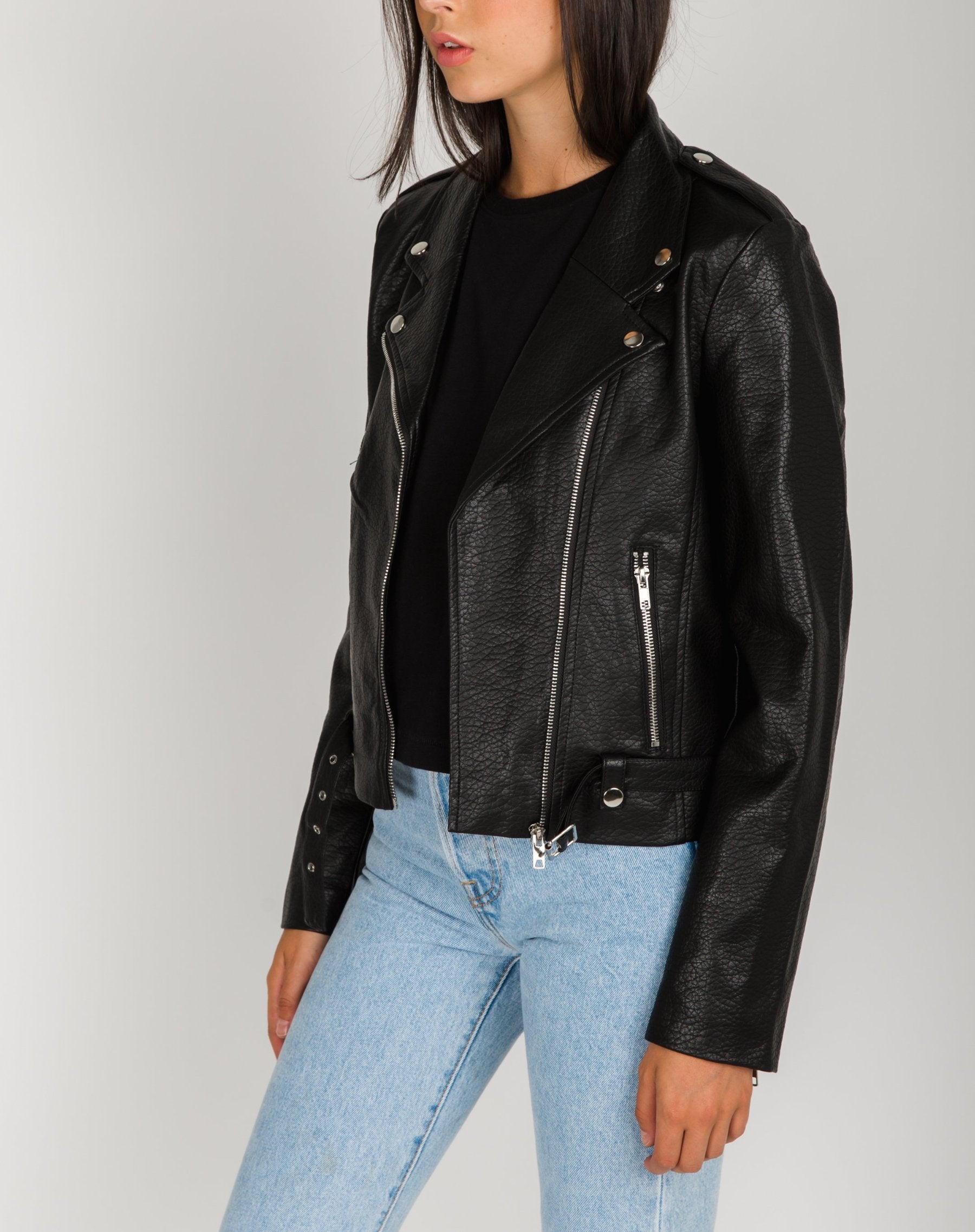 Left side photo of the Florence vegan leather moto jacket in black by Brunette the Label.
