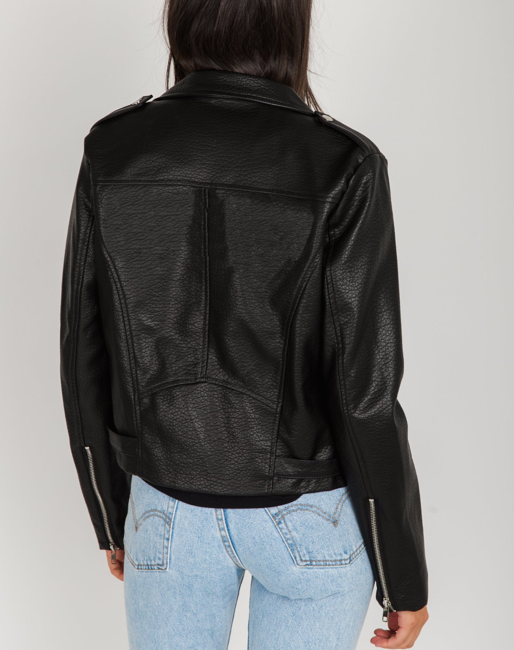 Photo of the back of the Florence vegan leather moto jacket in black by Brunette the Label.