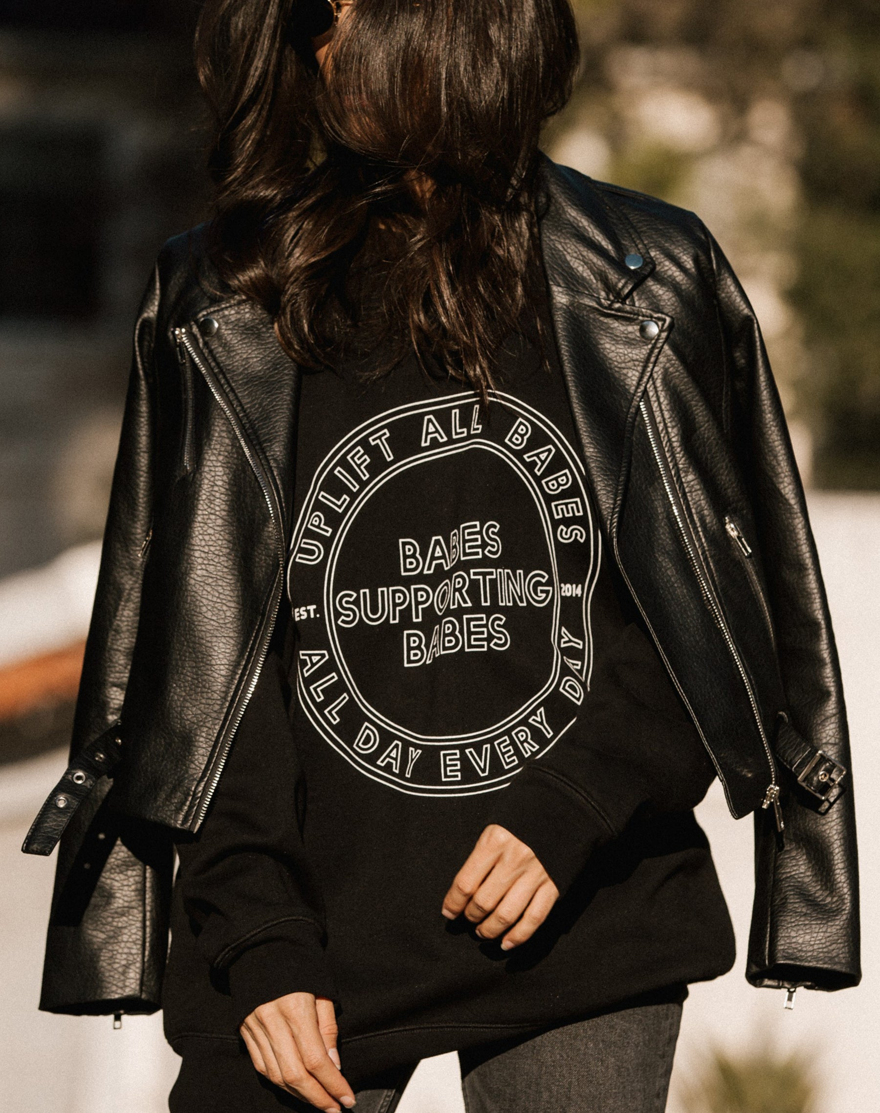 Photo of the Florence vegan leather moto jacket in black by Brunette the Label.