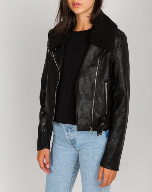 Photo of the Florence vegan leather moto jacket in black with shearling by Brunette the Label.