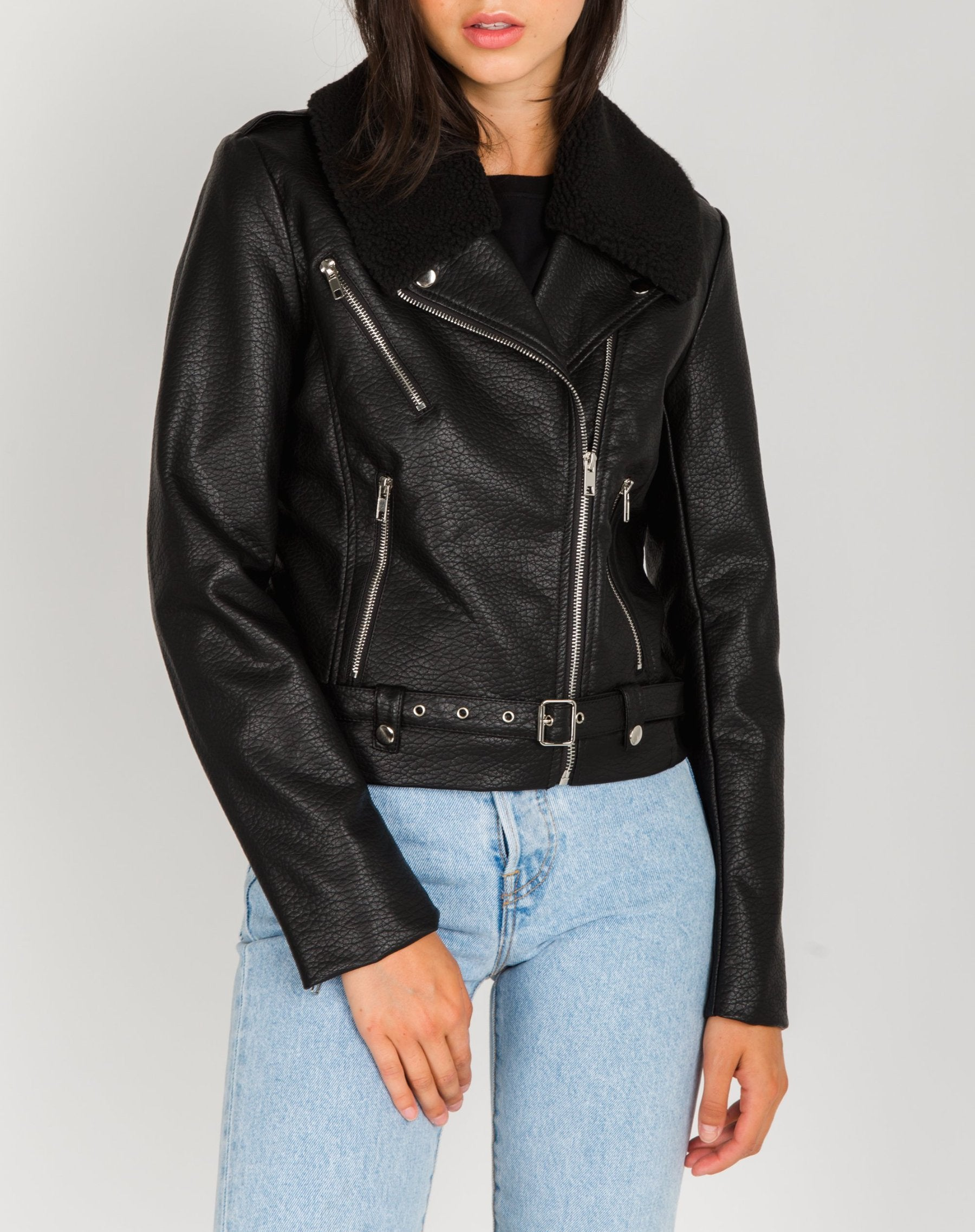 Photo of the Florence vegan leather moto jacket with shearling collar in black by Brunette the Label.