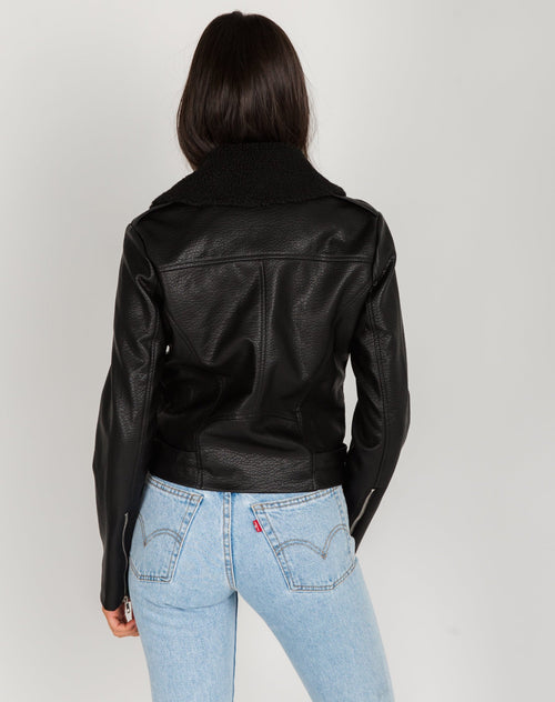 Photo of the back of the Florence vegan leather moto jacket with shearling collar in black by Brunette the Label.
