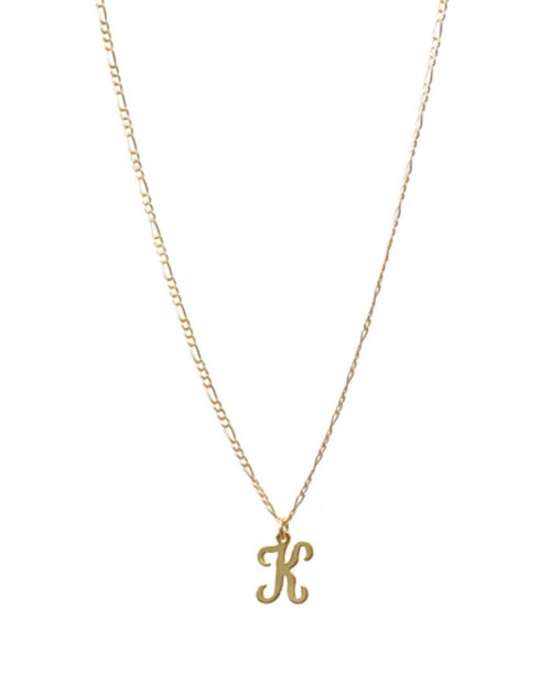 Photo of the K Initial necklace on gold figaro chain by Lisbeth.