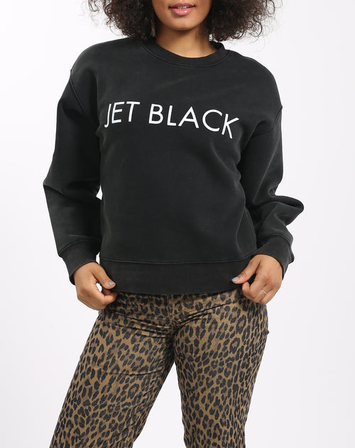 Photo 2 of the Jet Black Step Sister crew neck sweatshirt in acid wash by Brunette the Label.