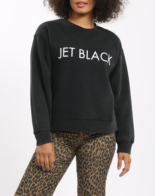 Photo of the Jet Black Step Sister crew neck sweatshirt in acid wash by Brunette the Label.