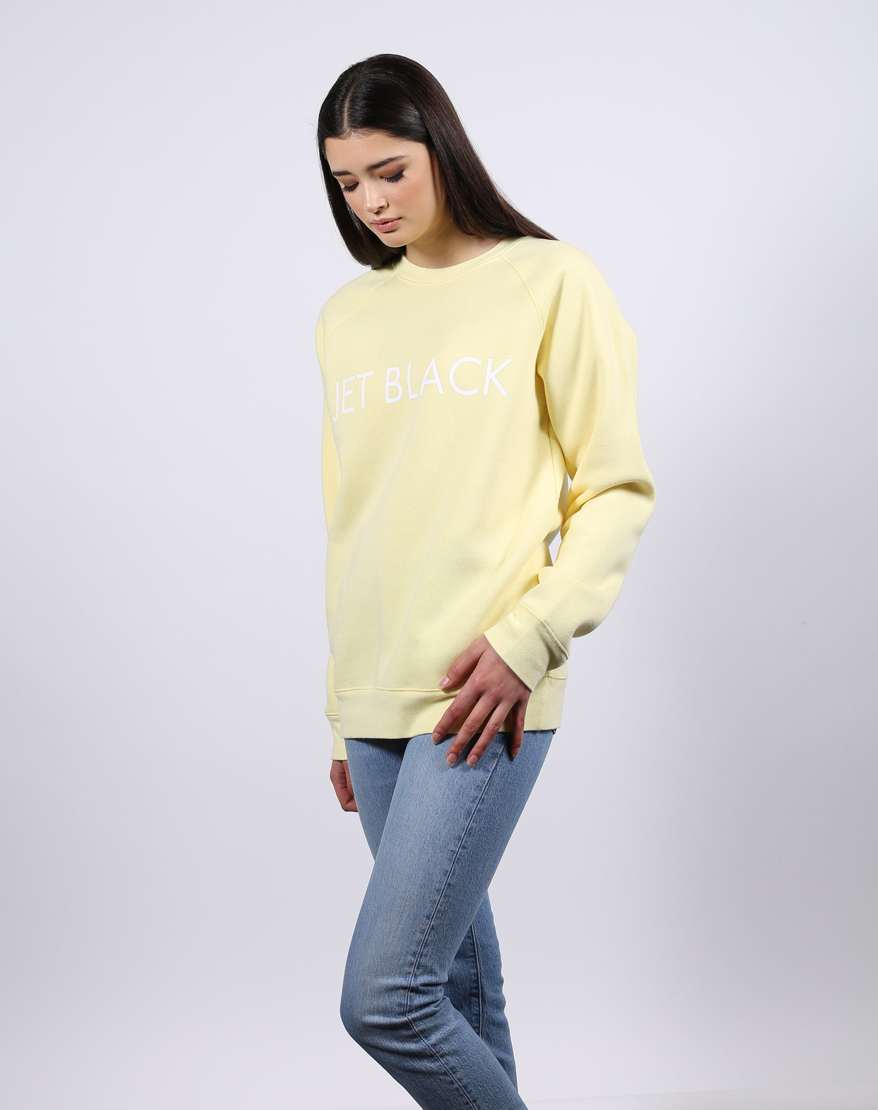 This is a Ecommerce photo of the Jet Black Lemon Classic Crew neck Sweatshirt by Brunette the Label