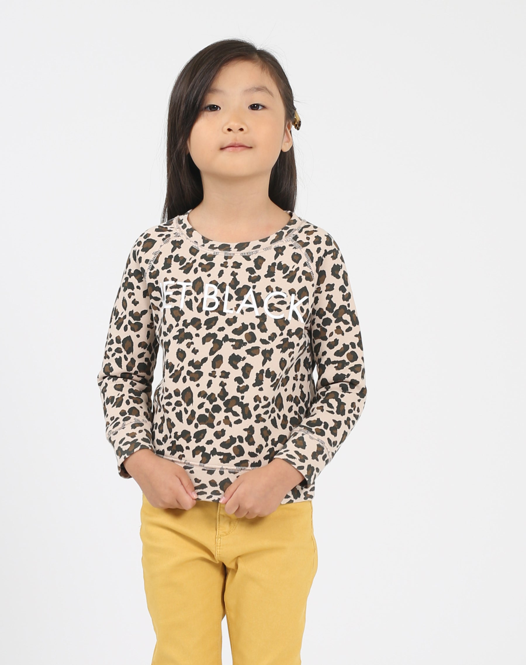 Photo of the Jet Black Little Babes classic crew neck sweatshirt in leopard by Brunette the Label.