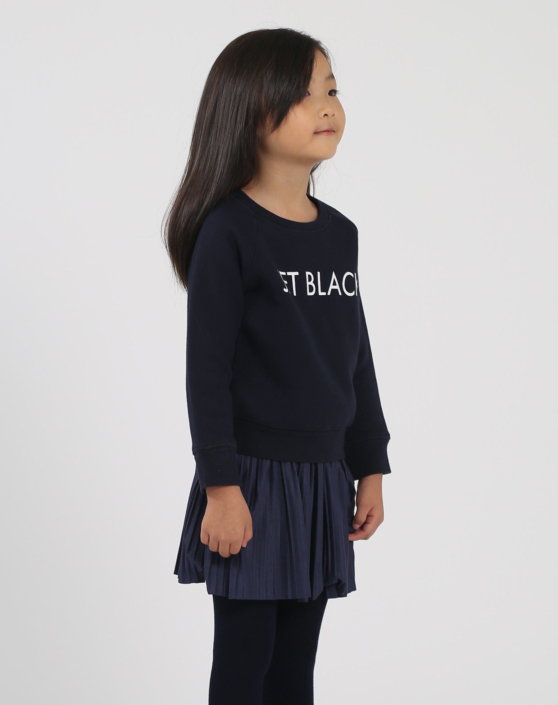 Side photo of the Jet Black Little Babes classic crew neck sweatshirt in navy by Brunette the Label.