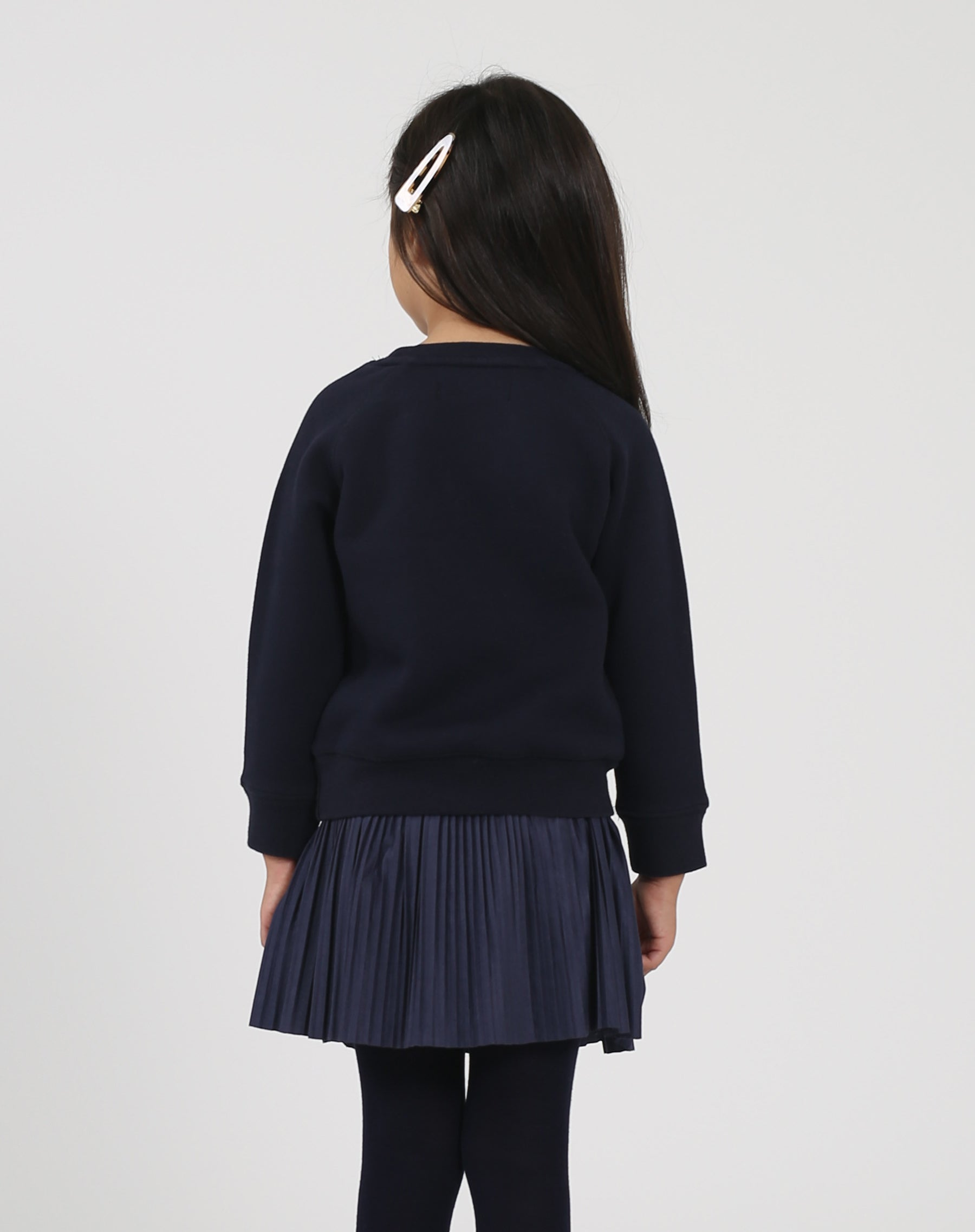 Photo of the back of the Jet Black Little Babes classic crew neck sweatshirt in navy by Brunette the Label.