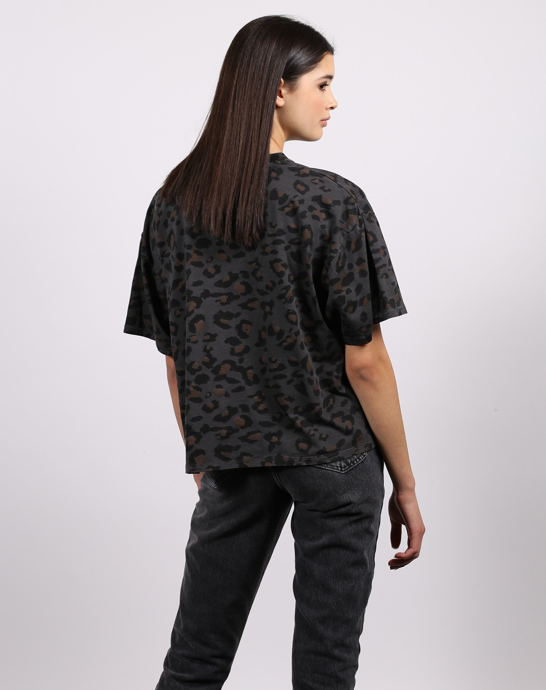 This is a photo of the back of the leopard 1981 slate grey boxy tee from brunette the label