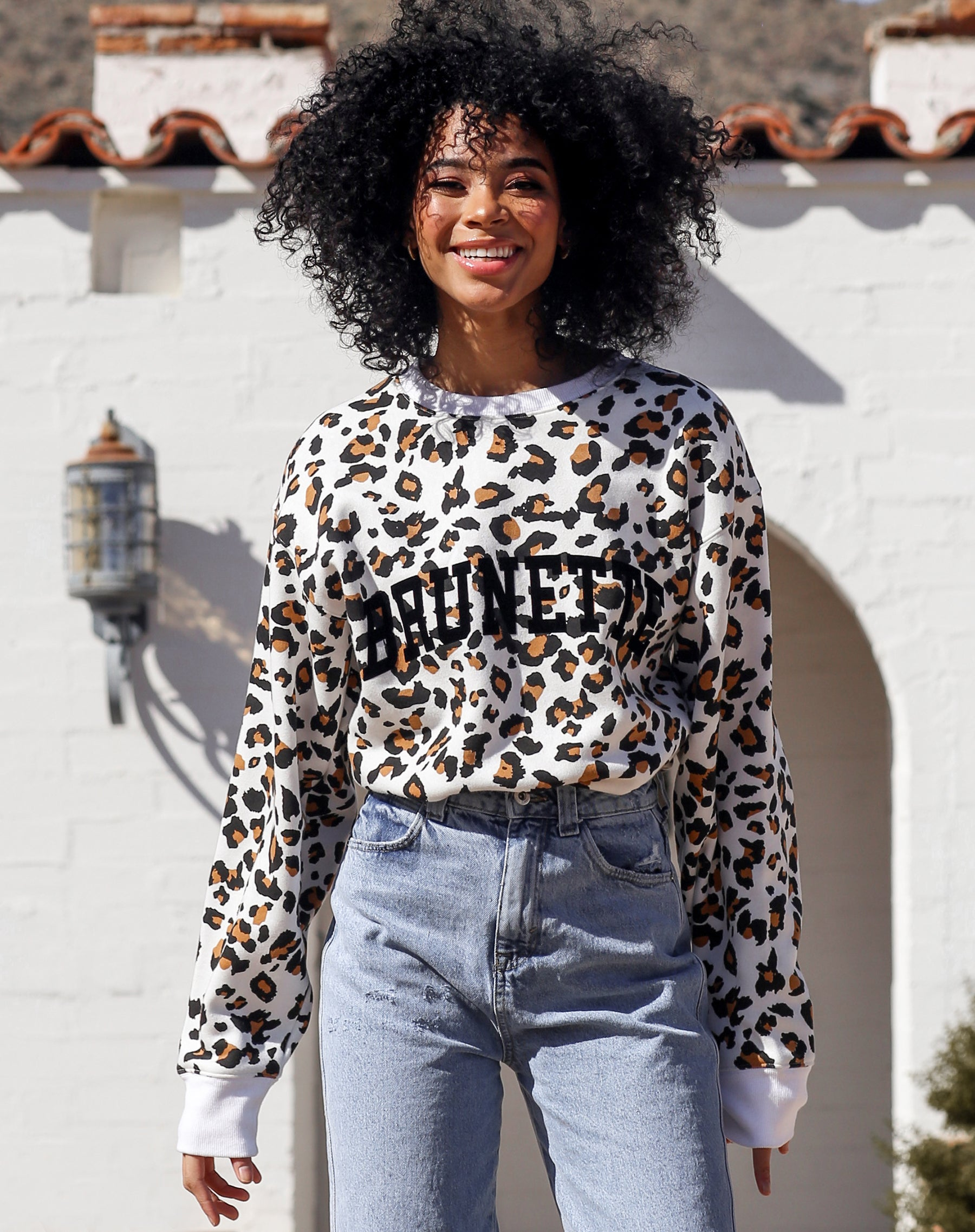 This is a campaign photo of the Brunette Step Sister Crew Neck Sweatshirt in White Leopard by Brunette the Label