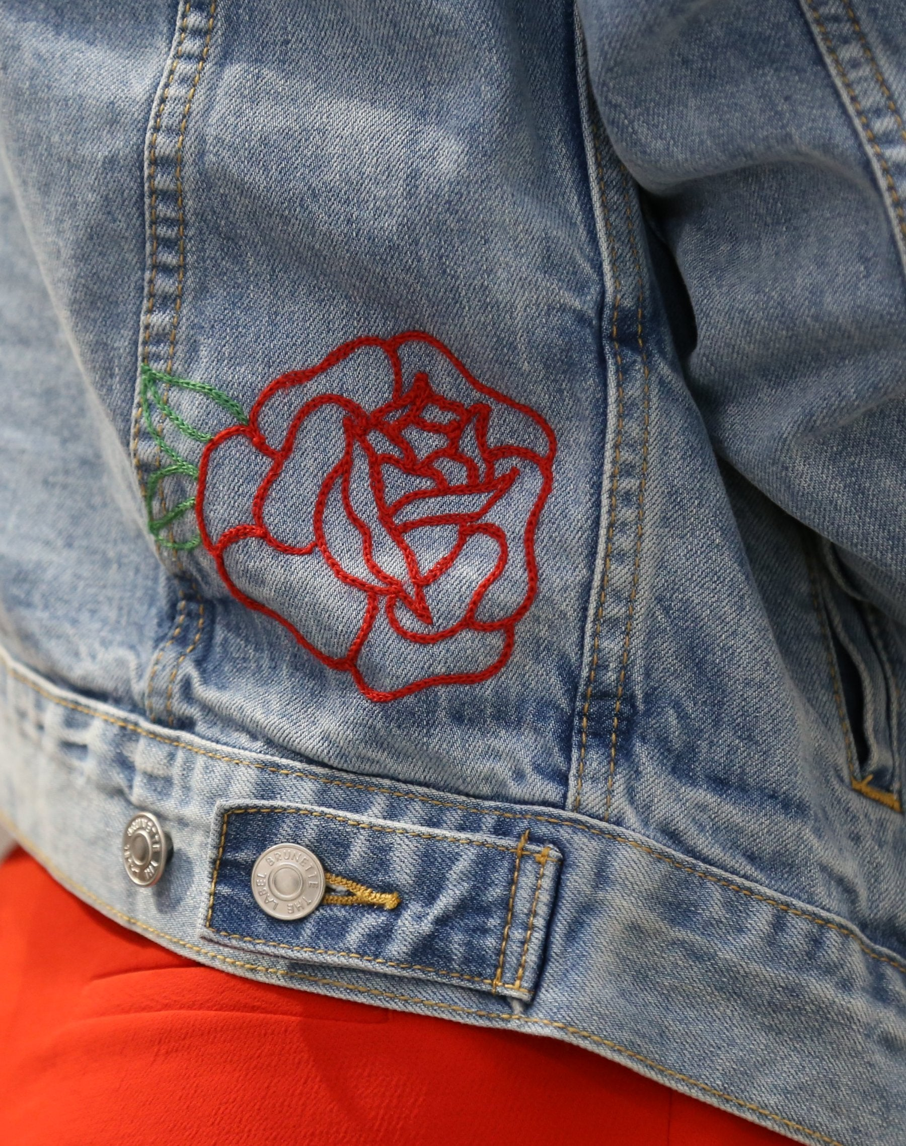 Photo of embroidered rose on the Lindsay denim jacket in light wash by Brunette the Label.