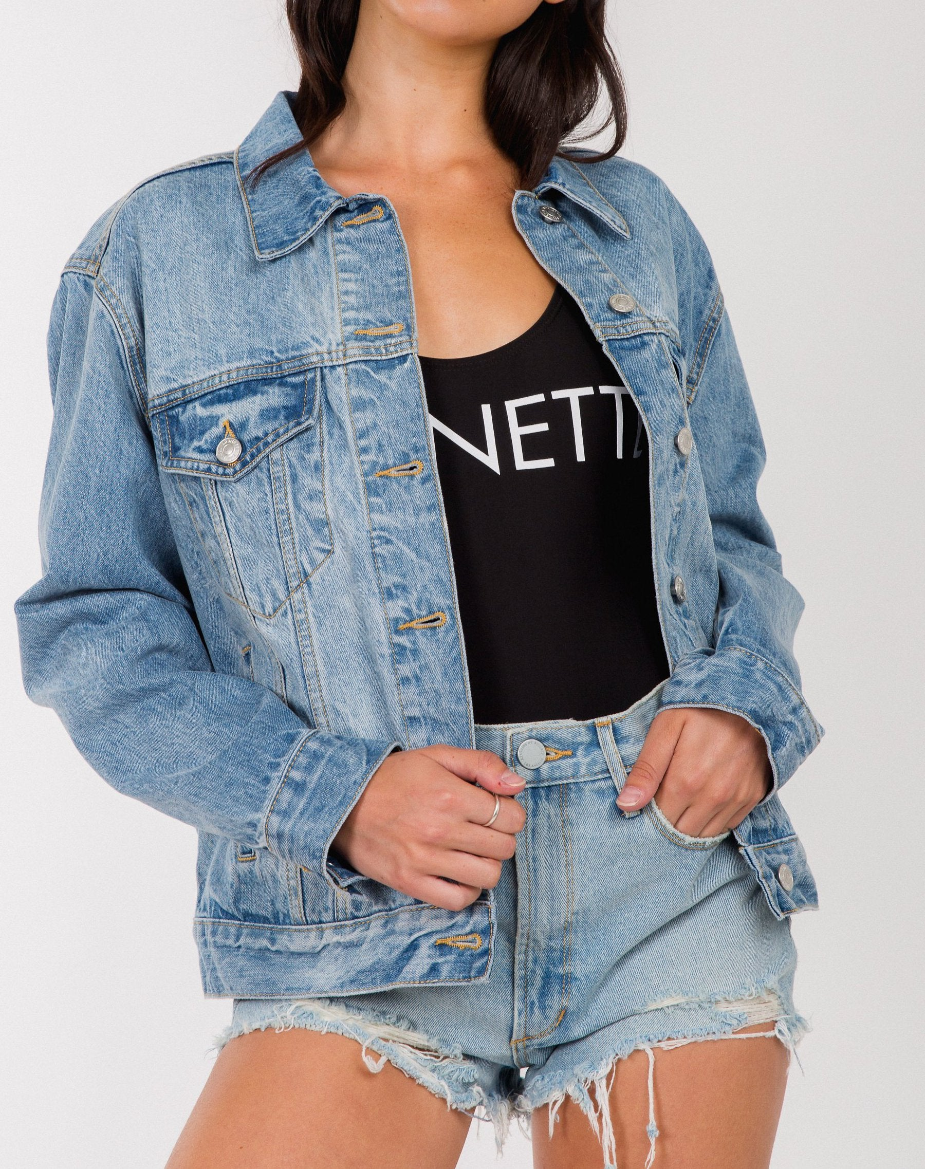 Photo of the Lindsay denim jacket in light wash by Brunette the Label.