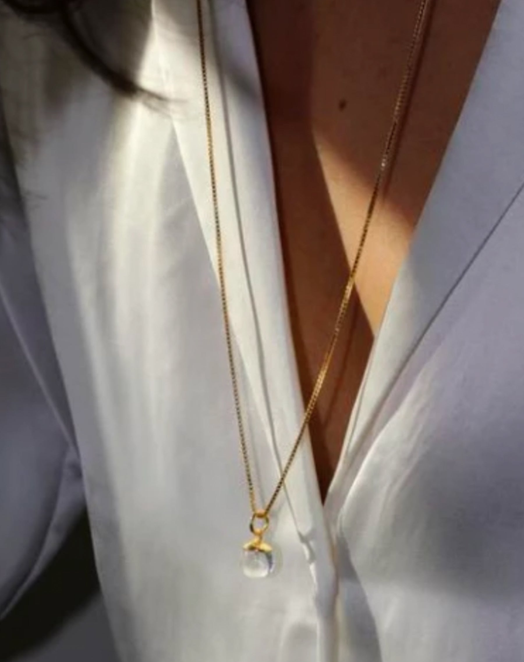 Image of the Lucite necklace in gold by Lisbeth.