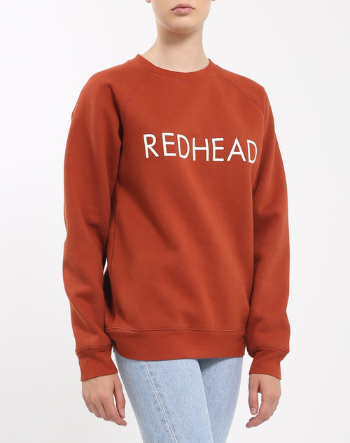Side photo of the Red Head classic crew neck sweatshirt in rust by Brunette the Label.