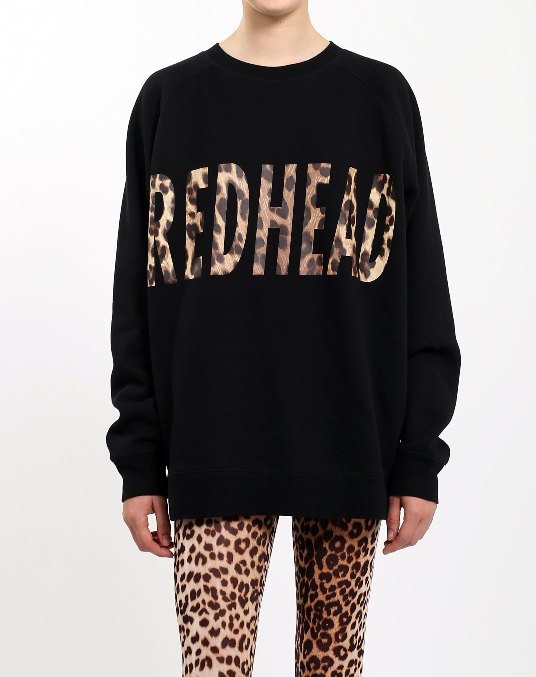Photo of the Redhead big sister crew neck sweatshirt in leopard by Brunette the Label.