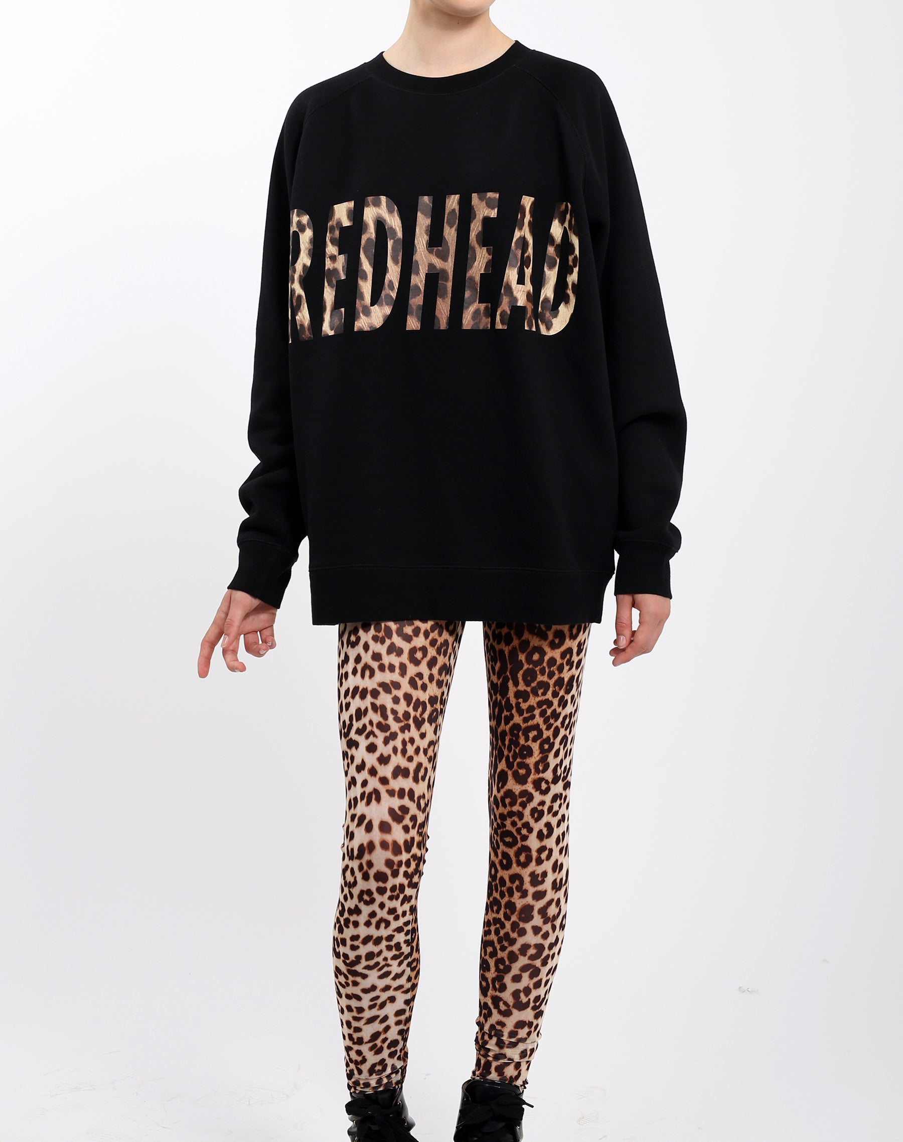 Photo 2 of the Redhead big sister crew neck sweatshirt in leopard by Brunette the Label.