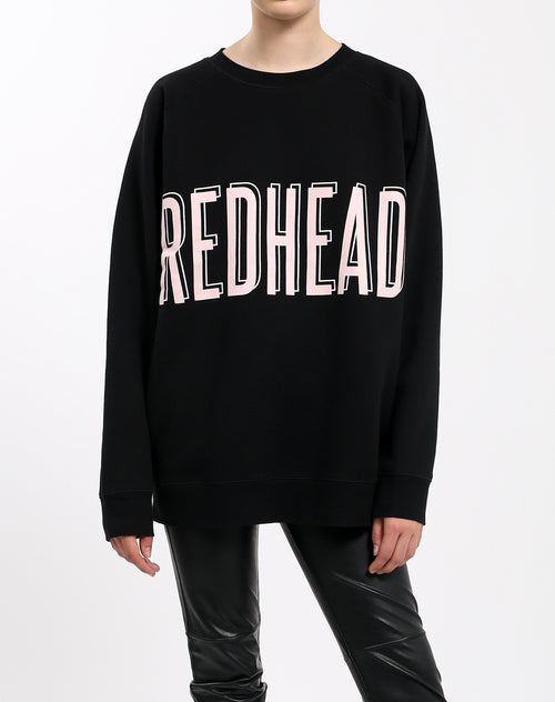 Photo of the Redhead big sister crew neck sweatshirt in pink by Brunette the Label.