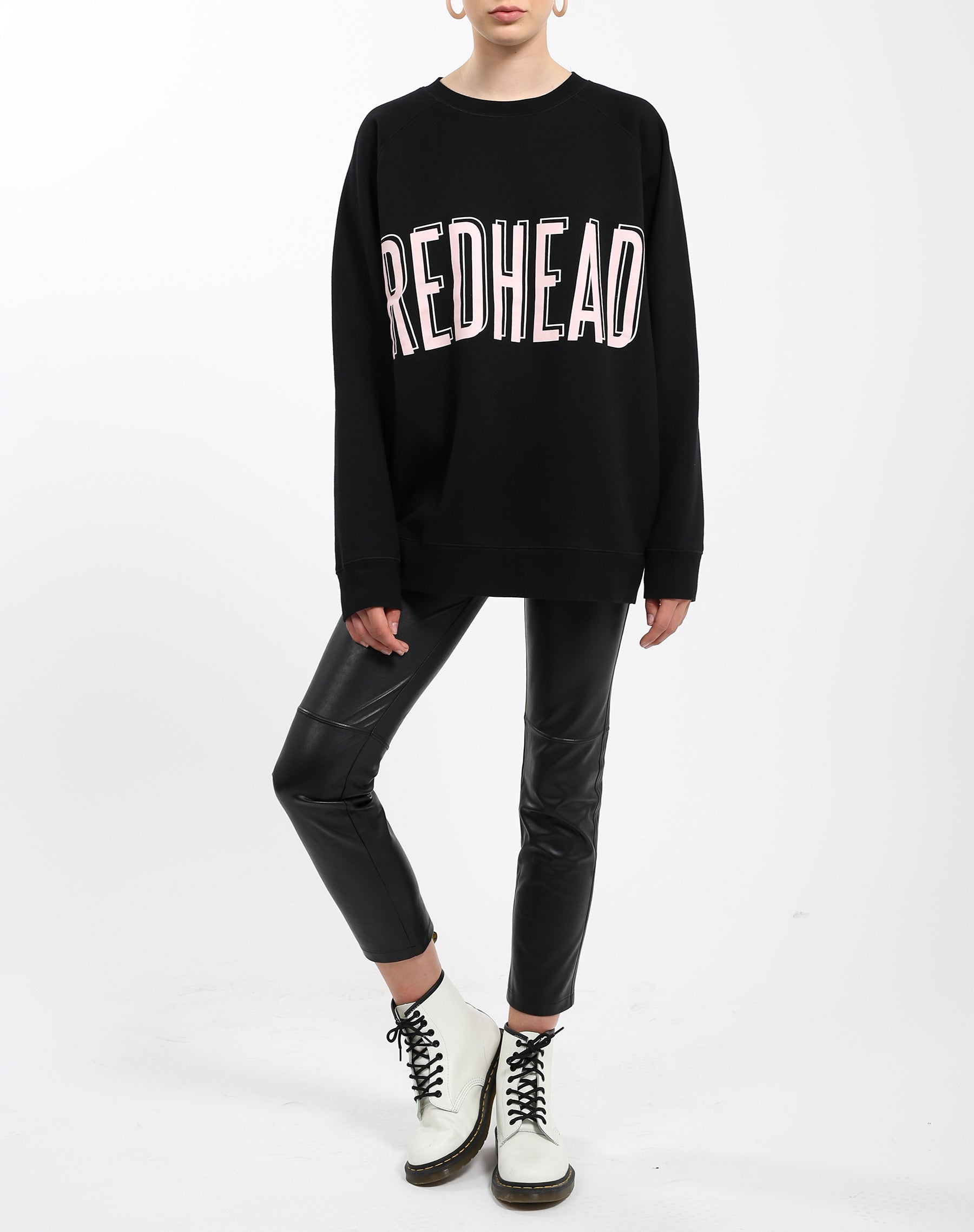 Photo 2 of the Redhead big sister crew neck sweatshirt in pink by Brunette the Label.