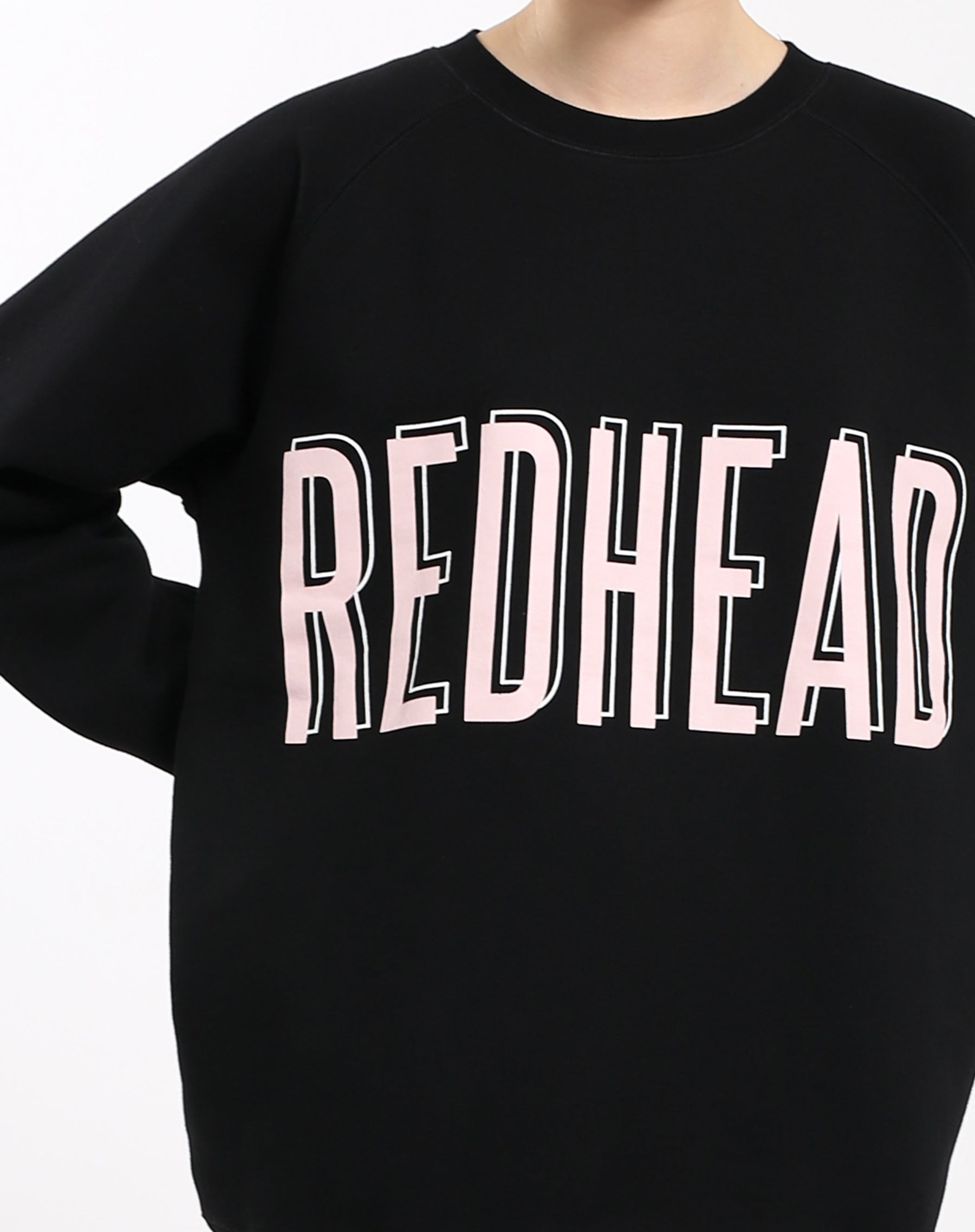 Photo 3 of the Redhead big sister crew neck sweatshirt in pink by Brunette the Label.