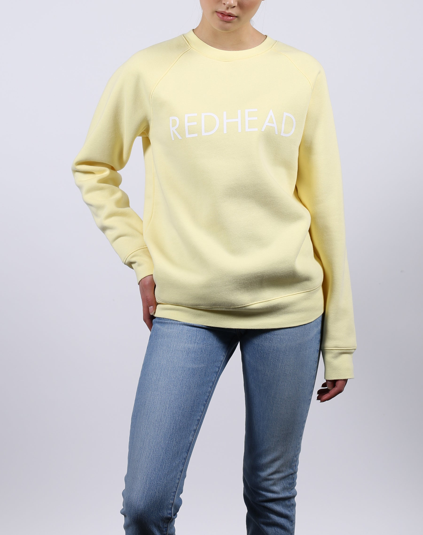 This is a Ecommerce photo of the Redhead Lemon Classic Crew neck Sweatshirt by Brunette the Label