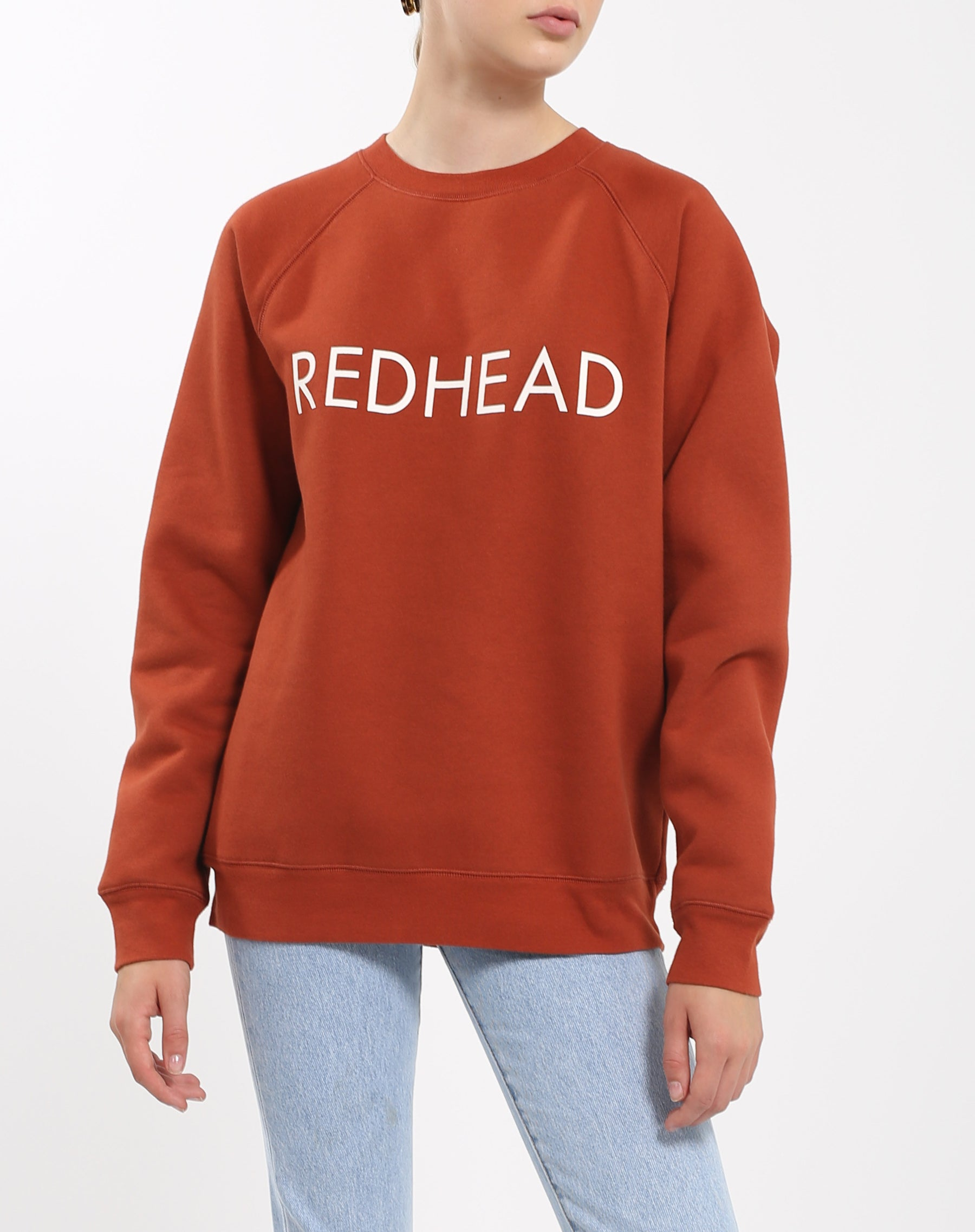 Photo of the Red Head classic crew neck sweatshirt in rust by Brunette the Label.